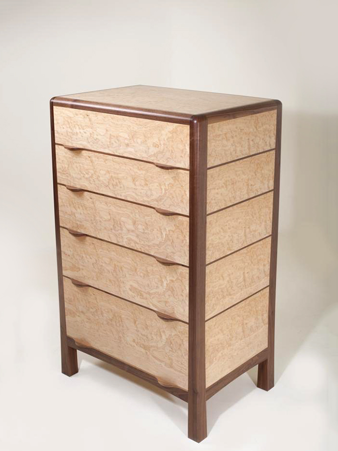 Tim Hagon's 'Oculi' Chest of Drawers. The frame is American Walnut with drawers in Artic Maple. The panel and draw fronts are Bird's Eye Maple.