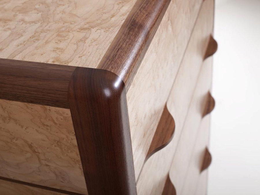 Detail view. Tim Hagon's 'Oculi' Chest of Drawers. The frame is American Walnut with drawers in Artic Maple. The panel and draw fronts are Bird's Eye Maple.