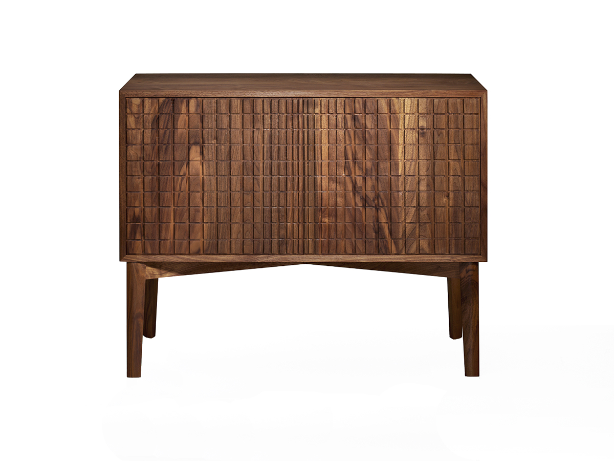 Chris Burley's 'Bridget' American Walnut Cabinet. The doors on this piece are inspired by Bridget Riley's 1964 painting 'Loss. The design on the doors is hand routed - the grooves graduating inwards to give the illusion that the doors curve into the centre.