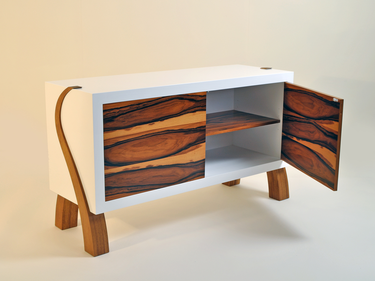 James Elliots 'Funk Soul' cabinet made of a sprayed white lightened core m.d.f carcase, and veneered Rosewood doors and solid Iroko legs.