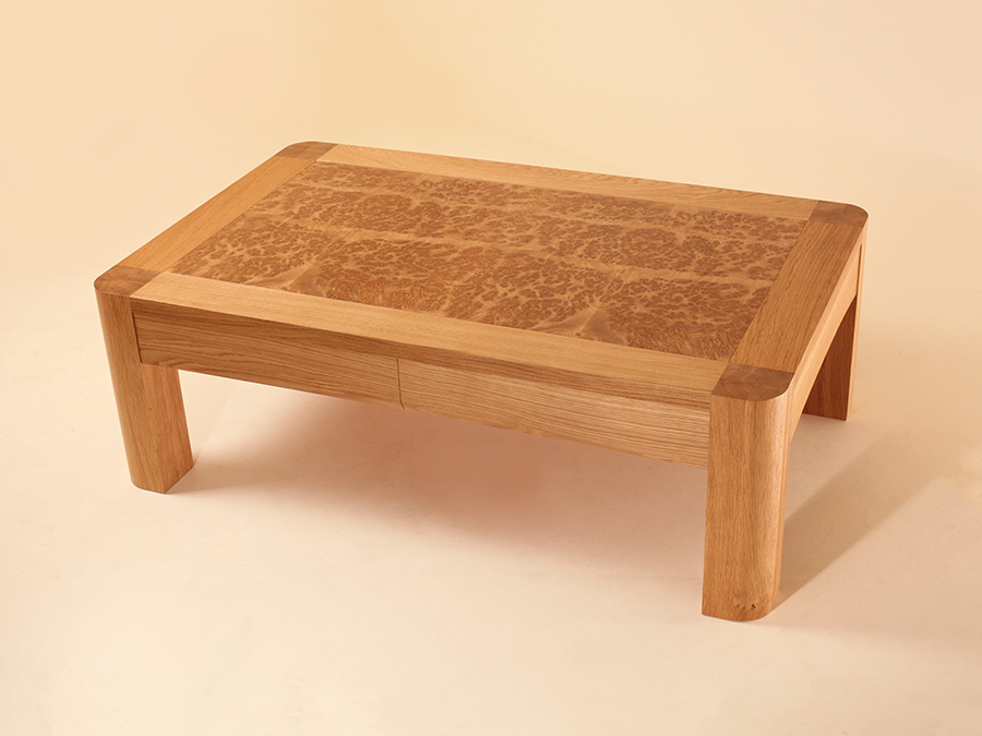 Tim Hagon's Oak and Burr Oak coffee table, with draws that when opened, reveal leather hammocks rather than traditional draw space.