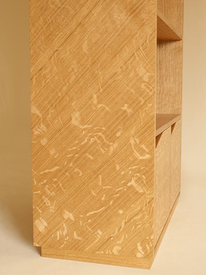 Finn James' angled Oak shelving with base storage.