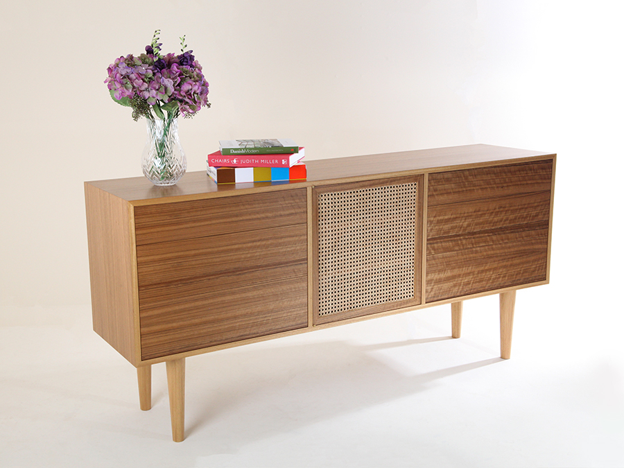 Ruth Bower's media unit constructed with a teak substitute veneer called Amazakoue, with a wicker door in the center locally grown in Somerset.
