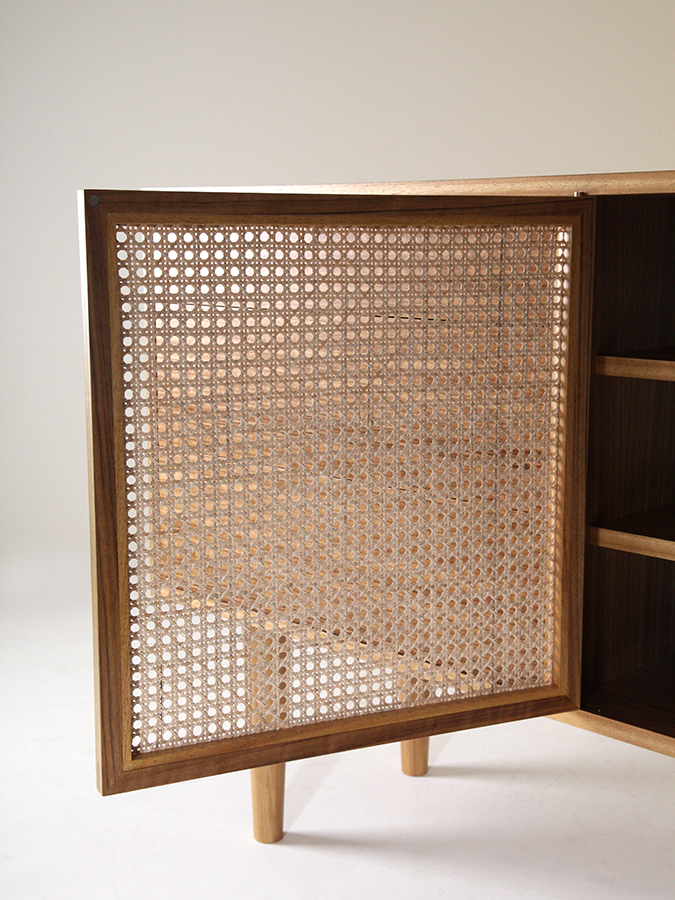 Detail view of the Somerset wicker door on Ruth Bower's Amazakoue media cabinet.