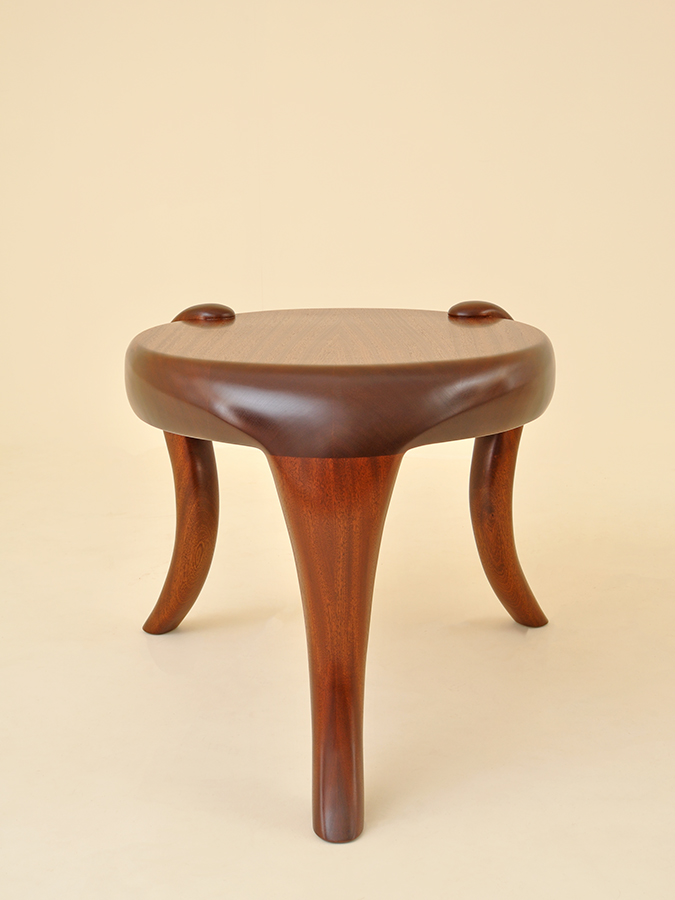 Kung Tongmee's 'Elephant' table. Kung's table is hand-sculpted in solid sapele - a beautiful sustainable hardwood. It's chunky lines and sensual curves evoke the power and elegance of an elephant.