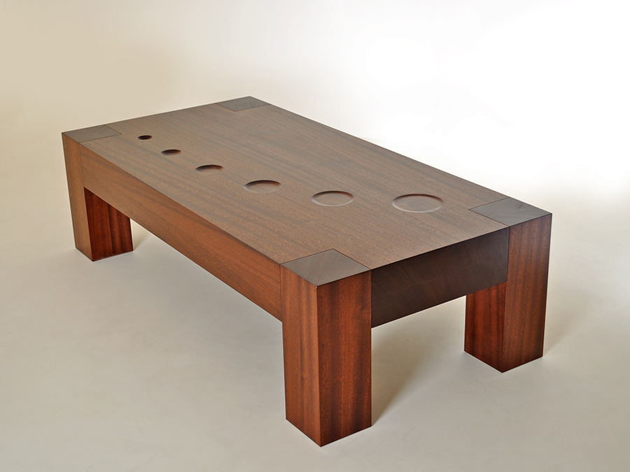 Kung Tongmee's Ripples coffee table hand crafted from sustainable sapele wood. Taking inspiration from meditation practice, the circles on the table surface represent the expansion of the mind as ripples on water.