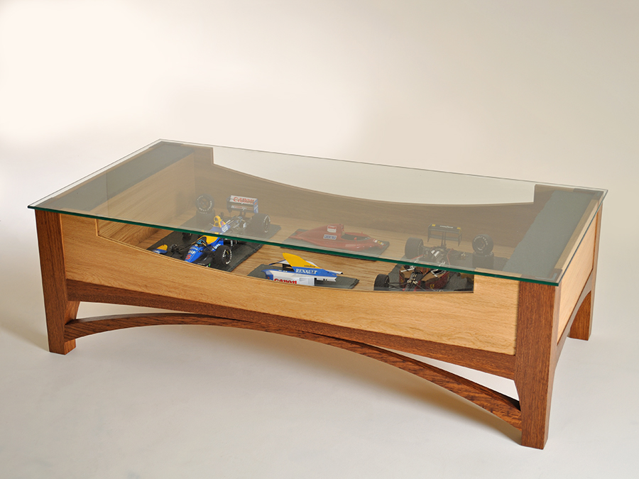Thomas Whittingham's 'Honister Vitrine' coffee table in European Oak, European Brown Oak, 'Honister' green slate and toughened glass. This table was made for a client to house scale model Formula one car replicas.