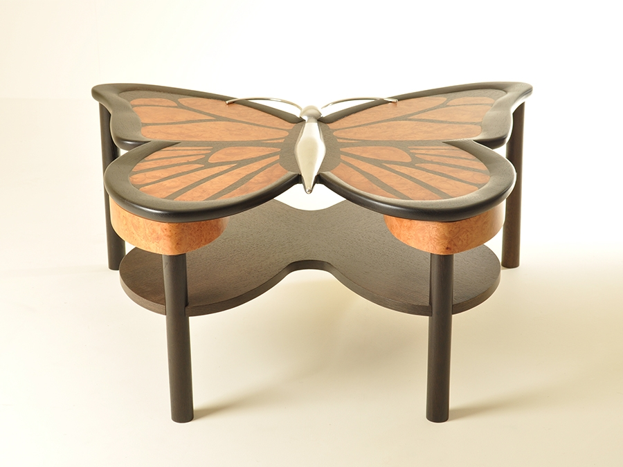 Adam Pierce's low butterfly table made in bog oak, burr maple and stainless steel.
