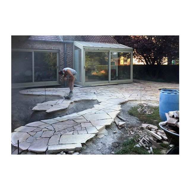 A talented mason is meticulously translating the curves into stone, after puzzling each piece into place.⁣ ⁣ #houseSAK #residential #redevelopment #curved #landscape #patio #stone #craftmanship⁣