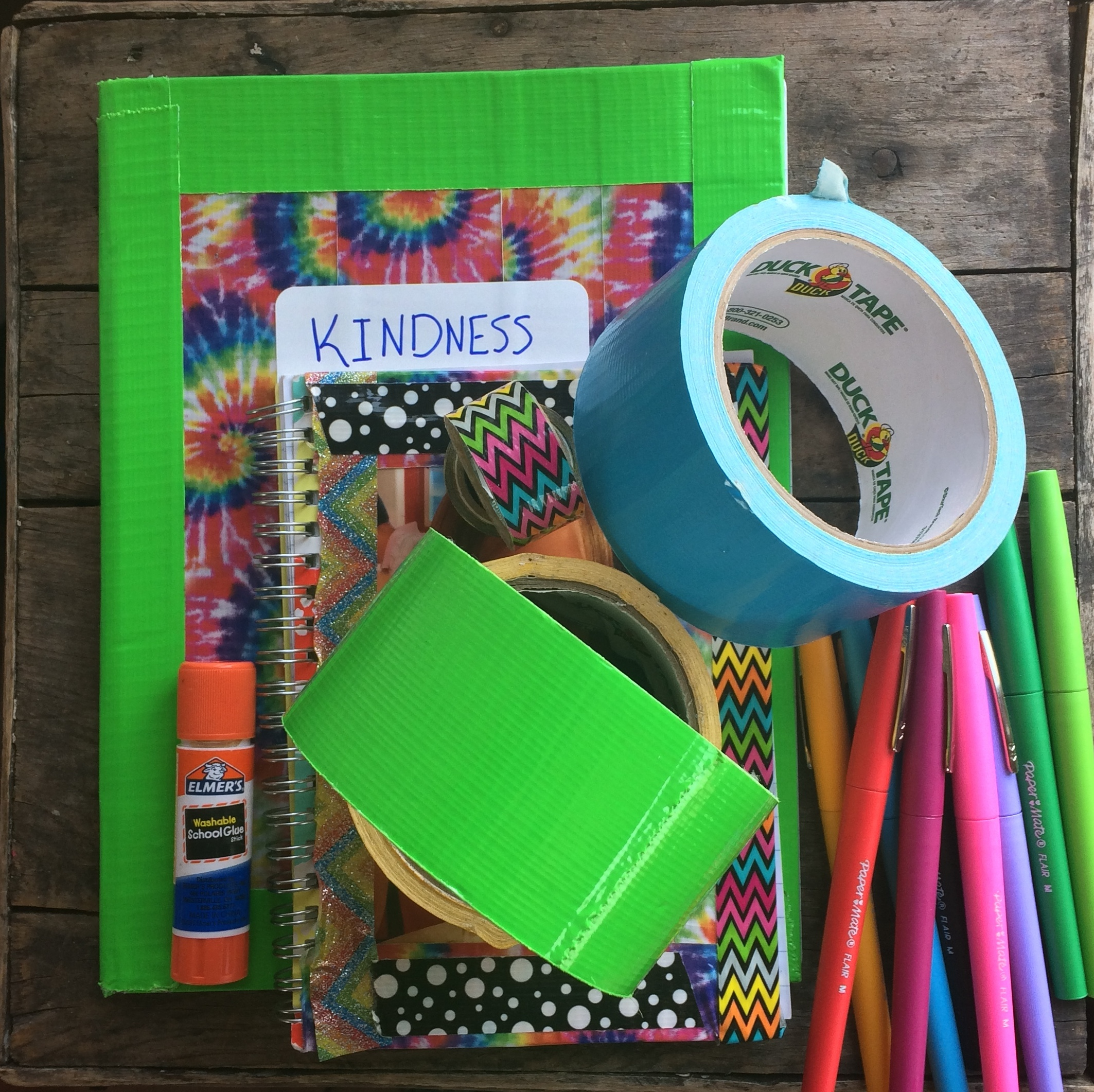 Decorate a composition notebook with duct tape. Scatter compassion-themed prompts and quotes throughout it. Then make time periodically to discuss, draw, and write about those kindness prompts as a family.