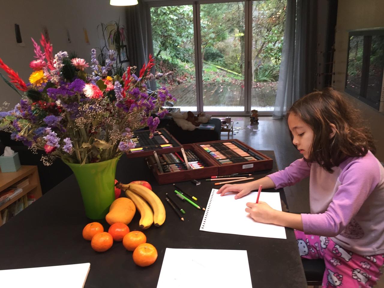 Madeline Alviar, second grader at McGilvra Elementary School, Seattle, Washington creates an art piece to benefit Seattle Children's Hospital