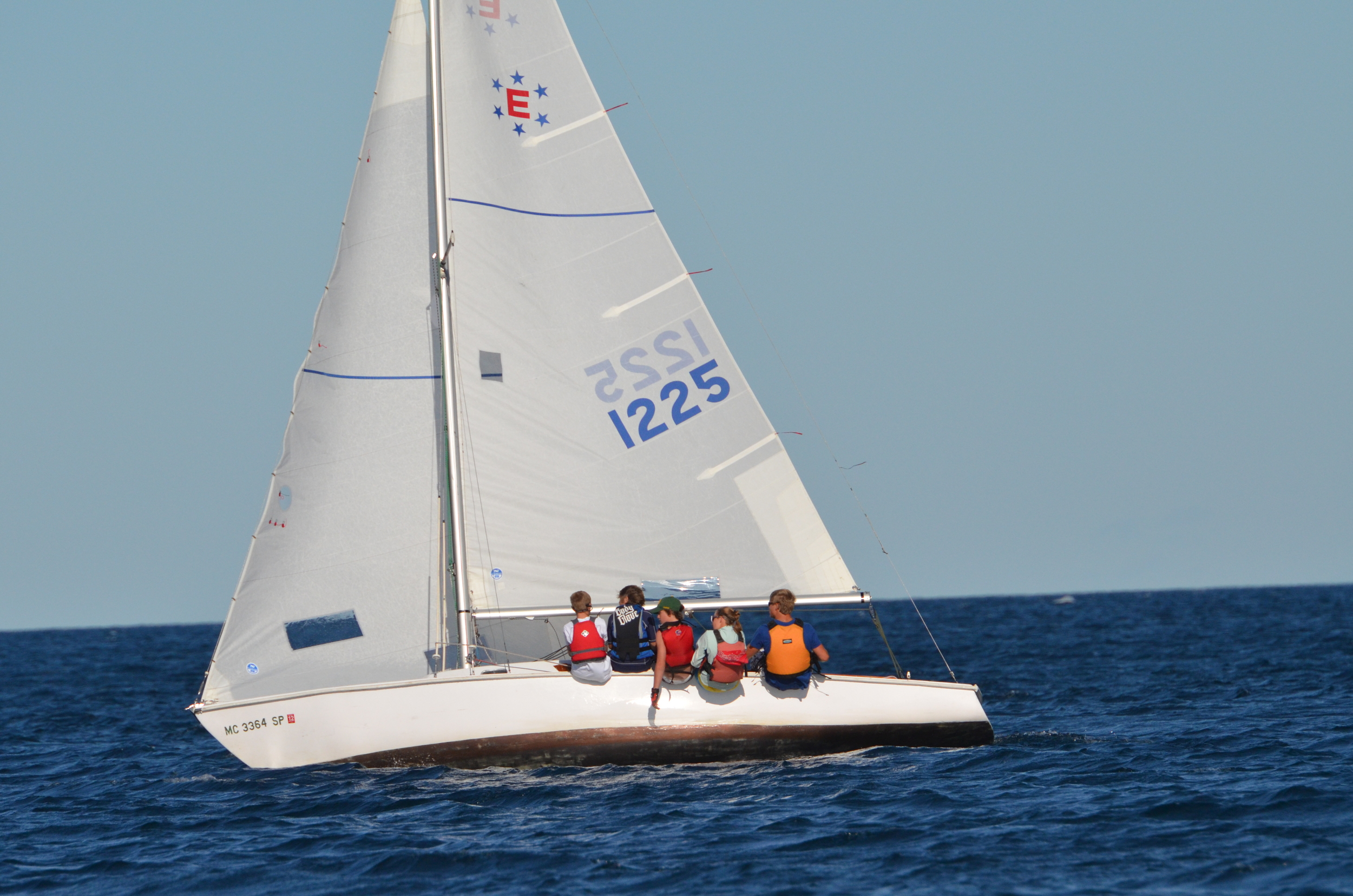 A youth team out racing in an Ensign.