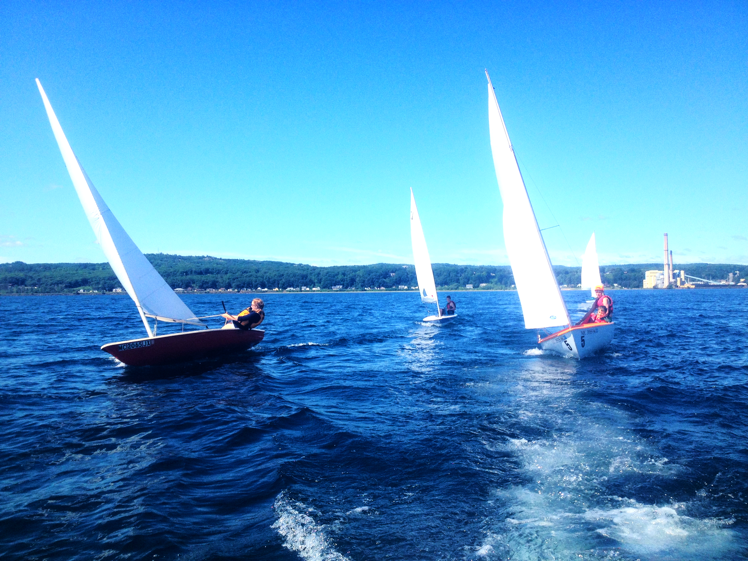 A group of MJYC boats sailing near Marquette in a nice breeze!