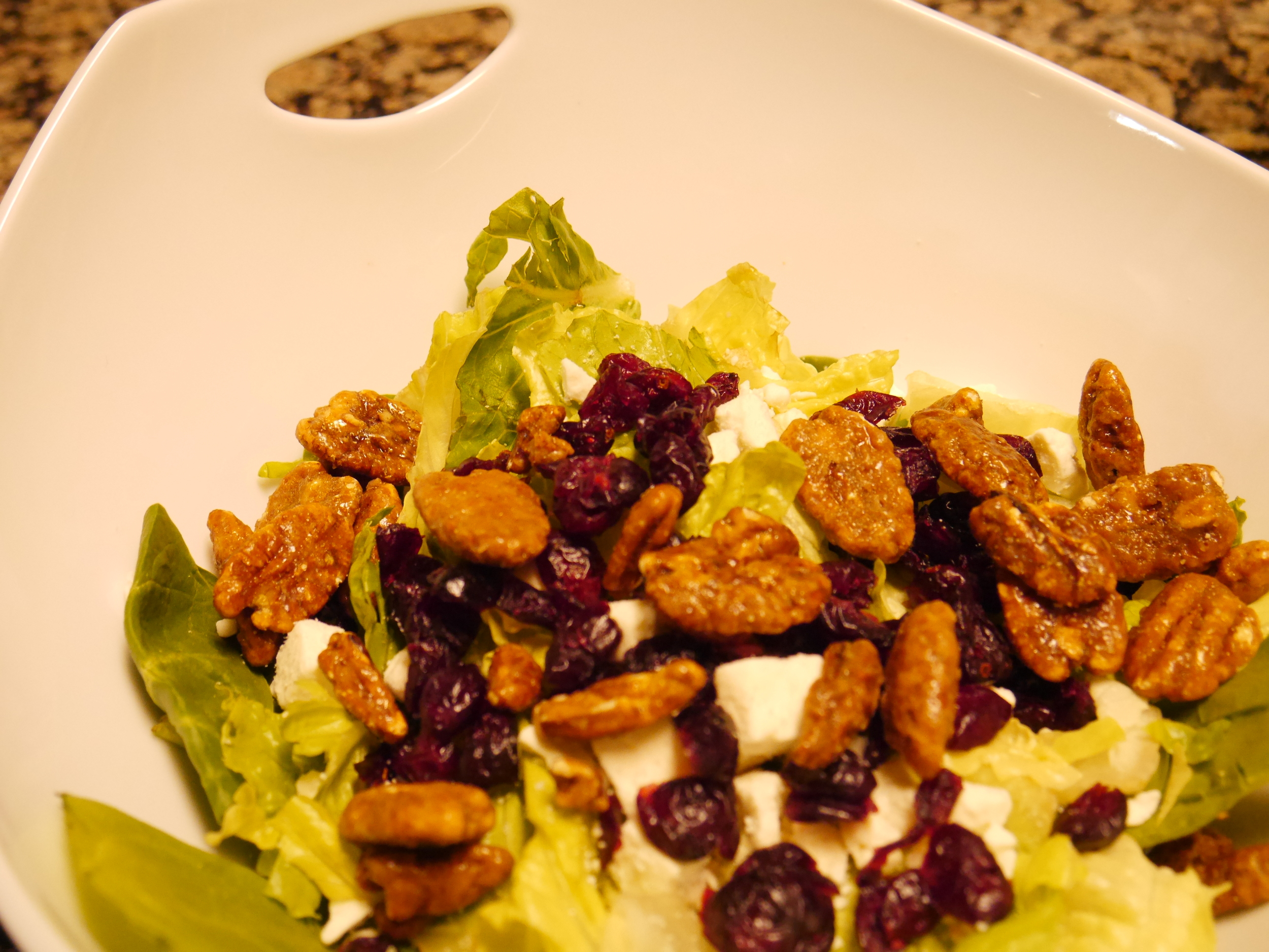 Spinach, romaine, feta, cranberry, and pecan salad.