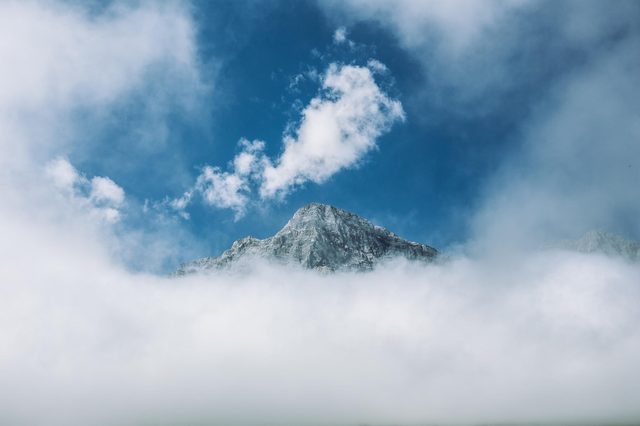 Goat Mountain peeking through the clouds.