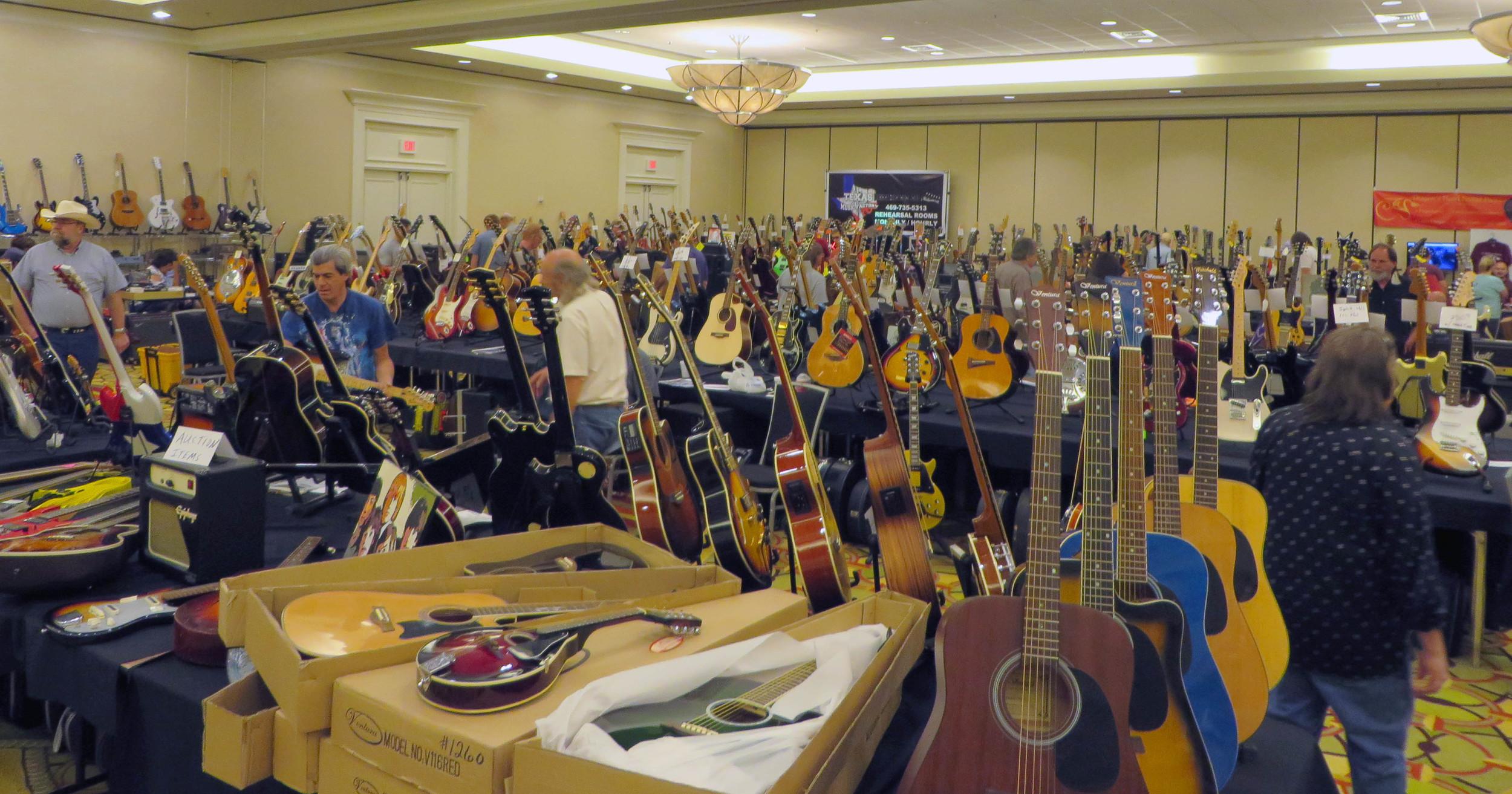 Guitars, guitars, and more guitars... and a mandolin.