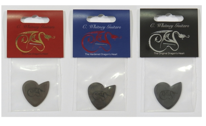 Pure, hardened, and original dragon's heart guitar picks in packaging