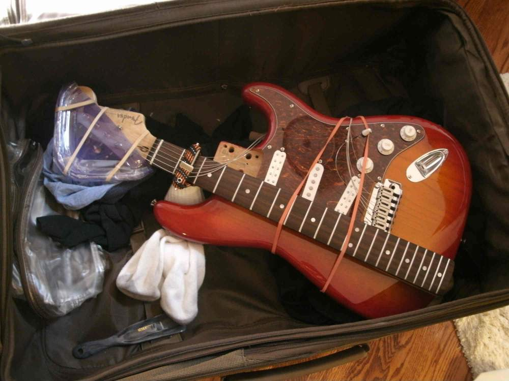 I suppose this is one way to pack your guitar for the trip but I don't recommend this one.