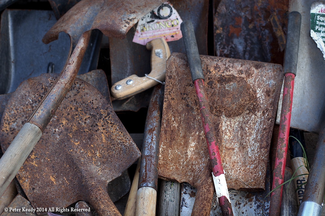 Tools. Worn out, rusty tools lay in a pile at our work camp in New Orleans nearly a year after Hurricane Katrina had ripped through the Gulf. The crazy thing about the photo is it was taken on July 4, 2006! I selected it for this piece and checked the date  after  I edited it! Pretty cool!