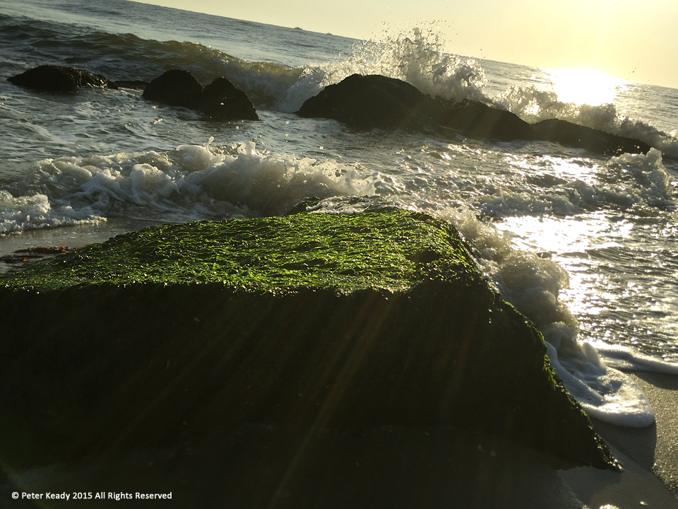 The surf pounds the rocks as vibrant moss lives in an atmosphere we cannot. Life is often hard and suffocating. But there's a promise of a new way to breathe while gasping for life. Long Branch, NJ.