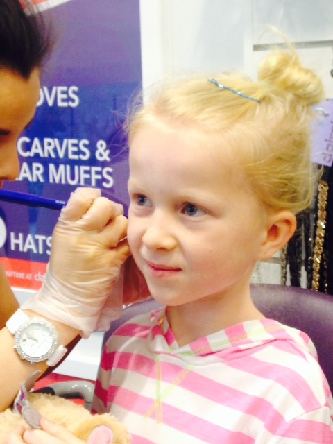 Abby getting her ears pierced. She was so brave!