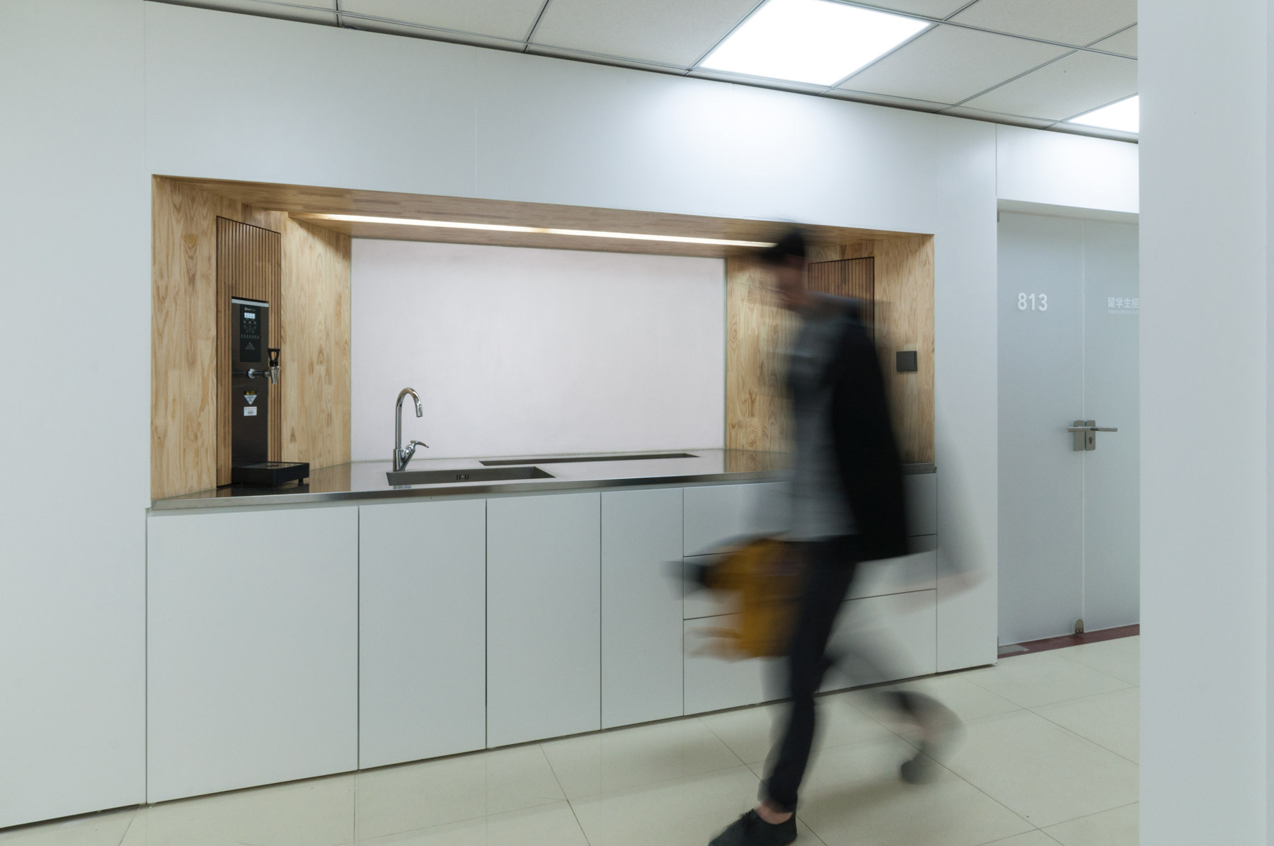Kitchen counter with integrated hot water and coffee machines