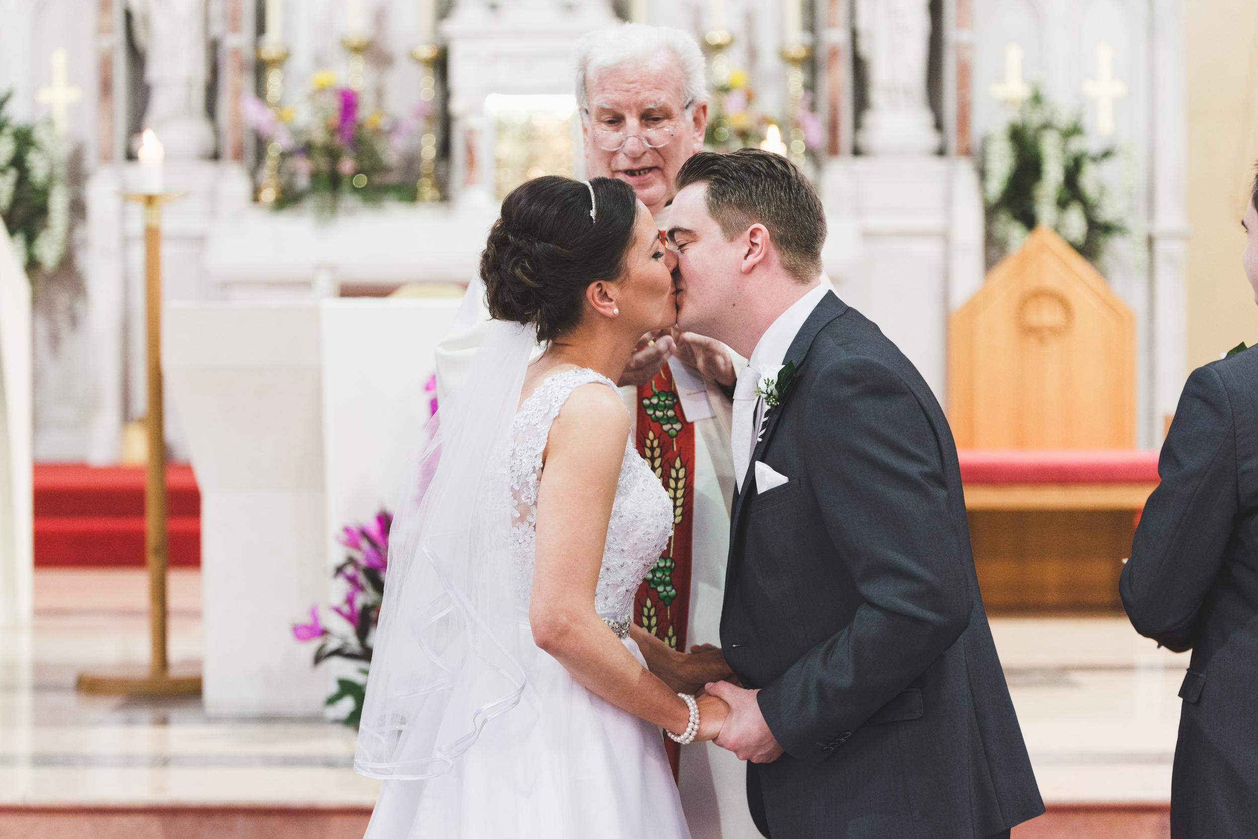 Lisburn_Wedding_Photographer_The_Groom_and_Bride_Kiss