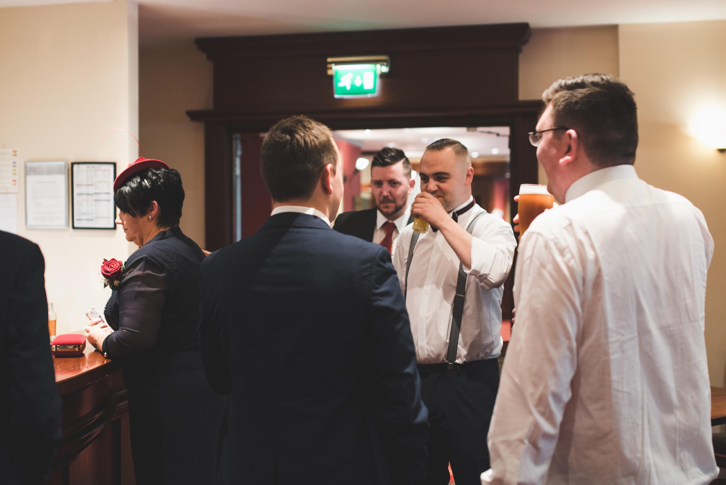 Northern_Ireland_Wedding_Photographer_Purephotoni_Dunsilly_Hotel_Groom_Drinking