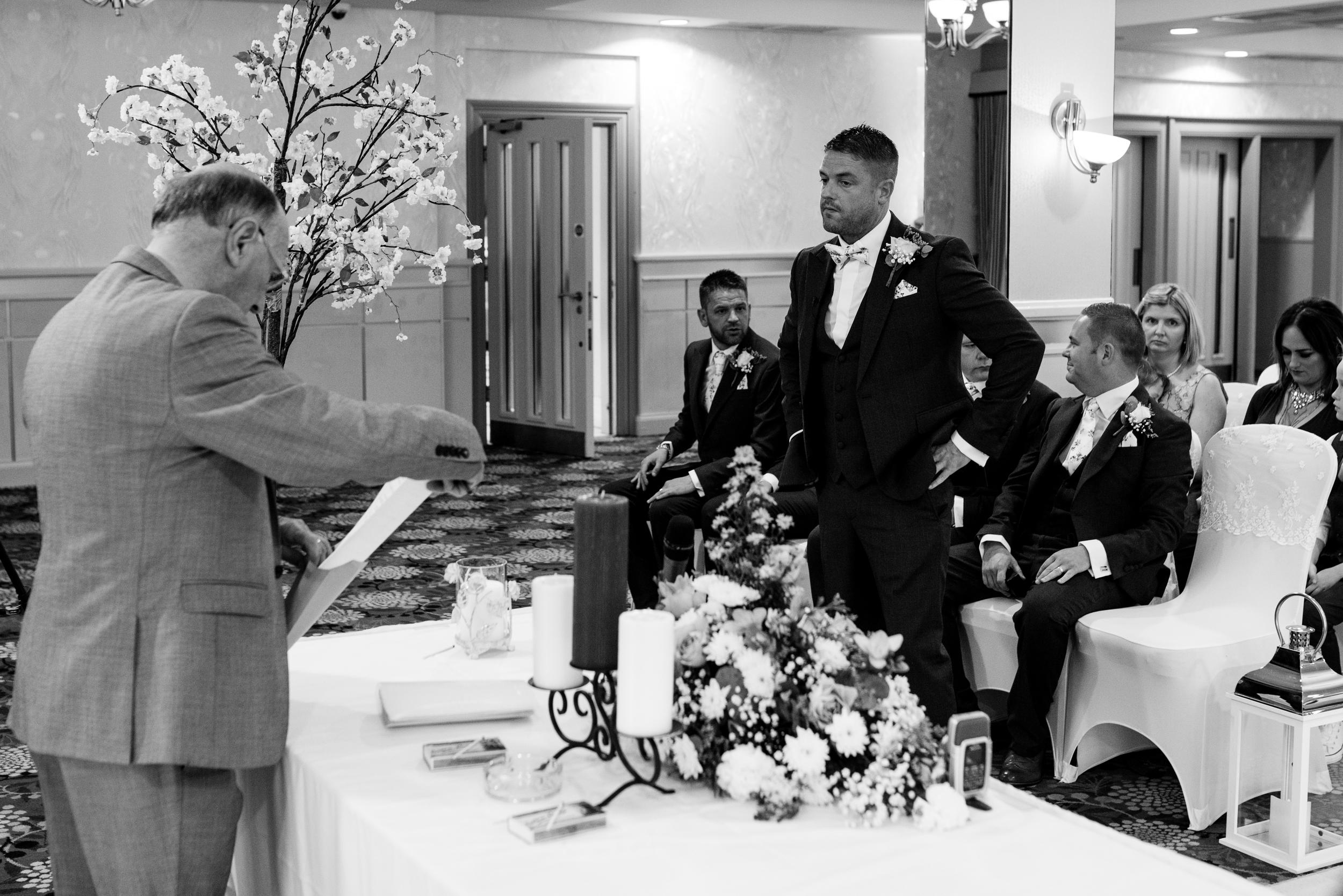 Belfast Wedding Photographer purephotoni Ramada Plaza ceremony groom waiting