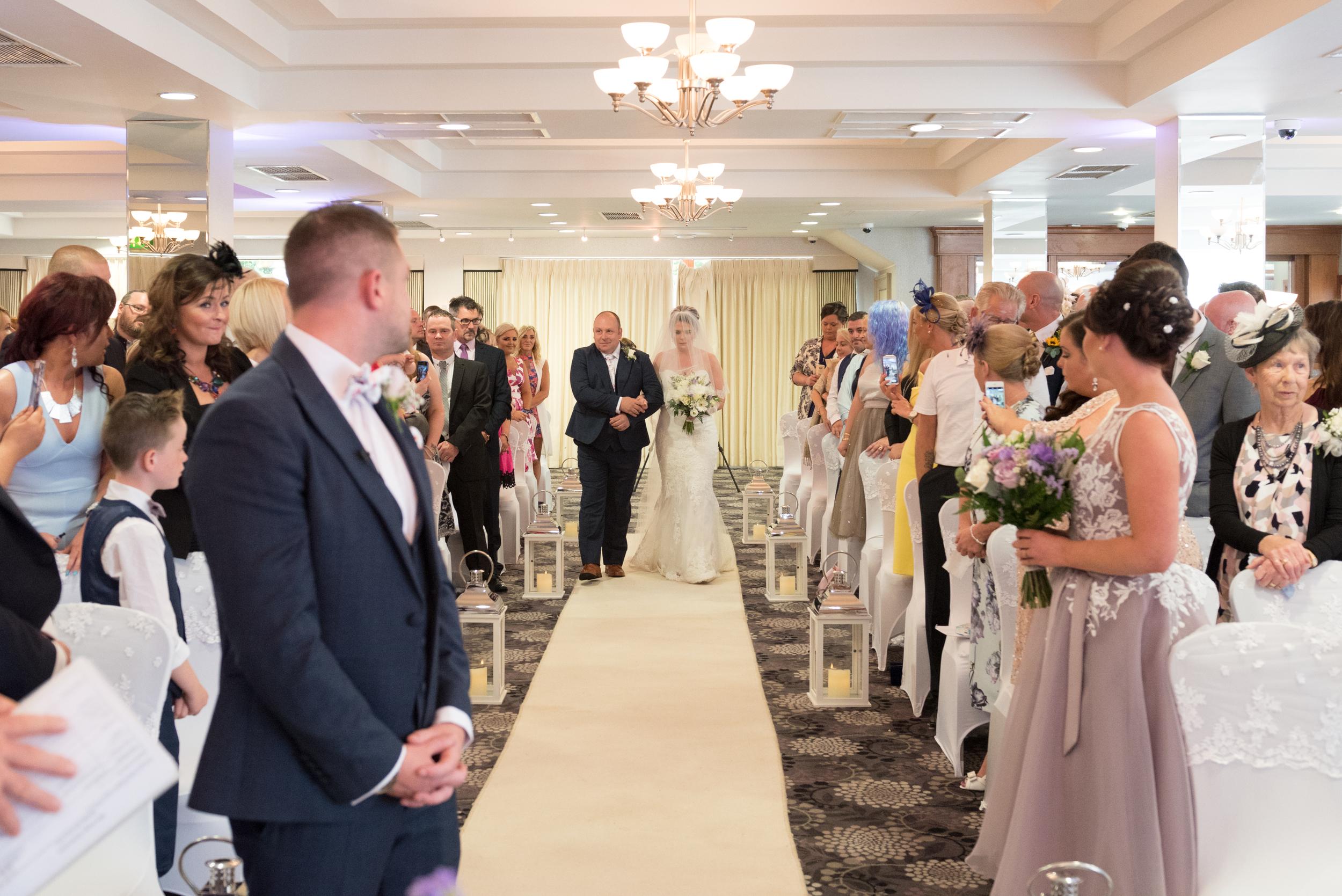 Belfast Wedding Photographer purephotoni Ramada Plaza bride aisle