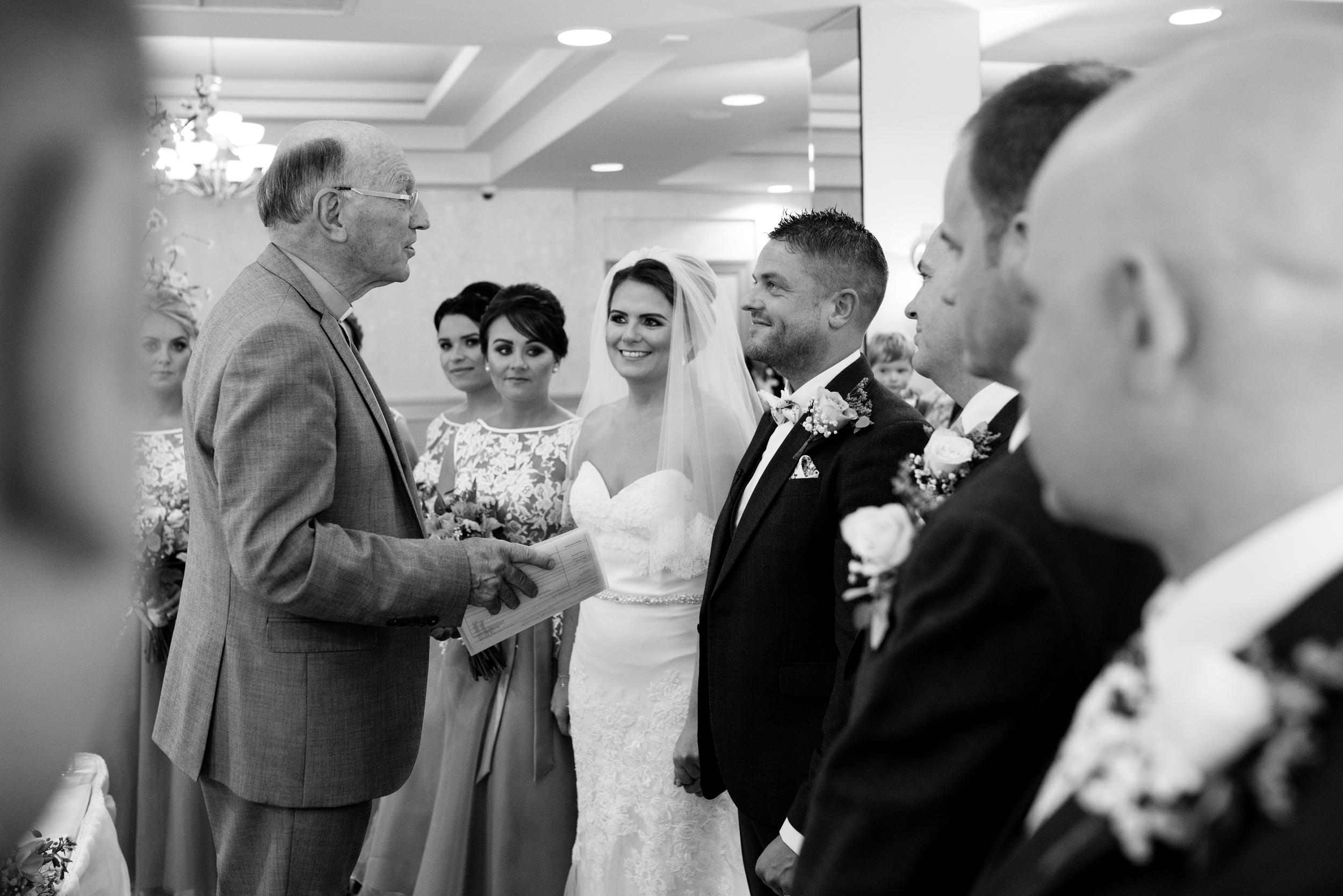 Belfast Wedding Photographer purephotoni Ramada Plaza ceremony bride and groom mono