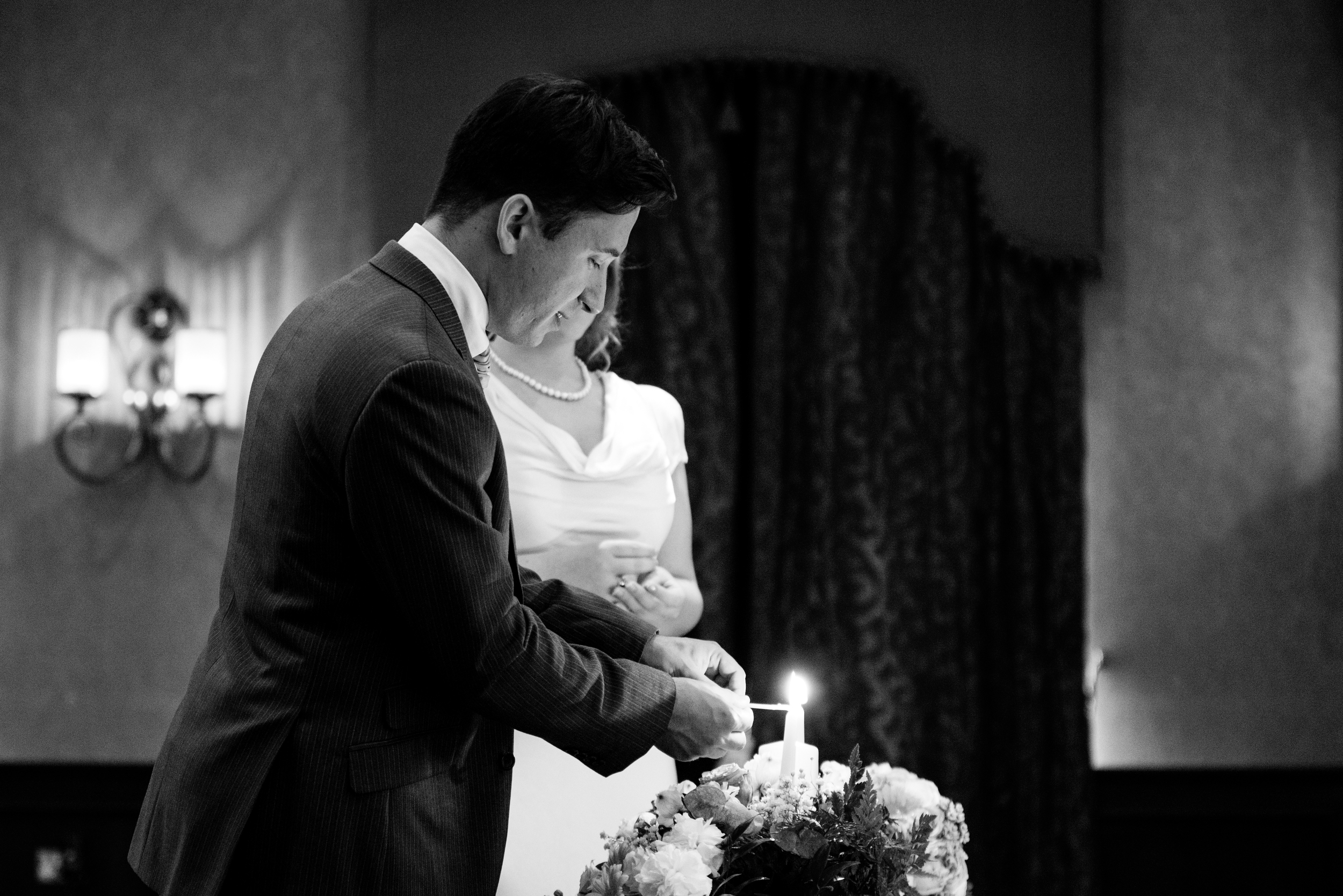 Canal Court Hotel Newry Wedding photographer Pure Photo N.I ceremony groom lighting candle
