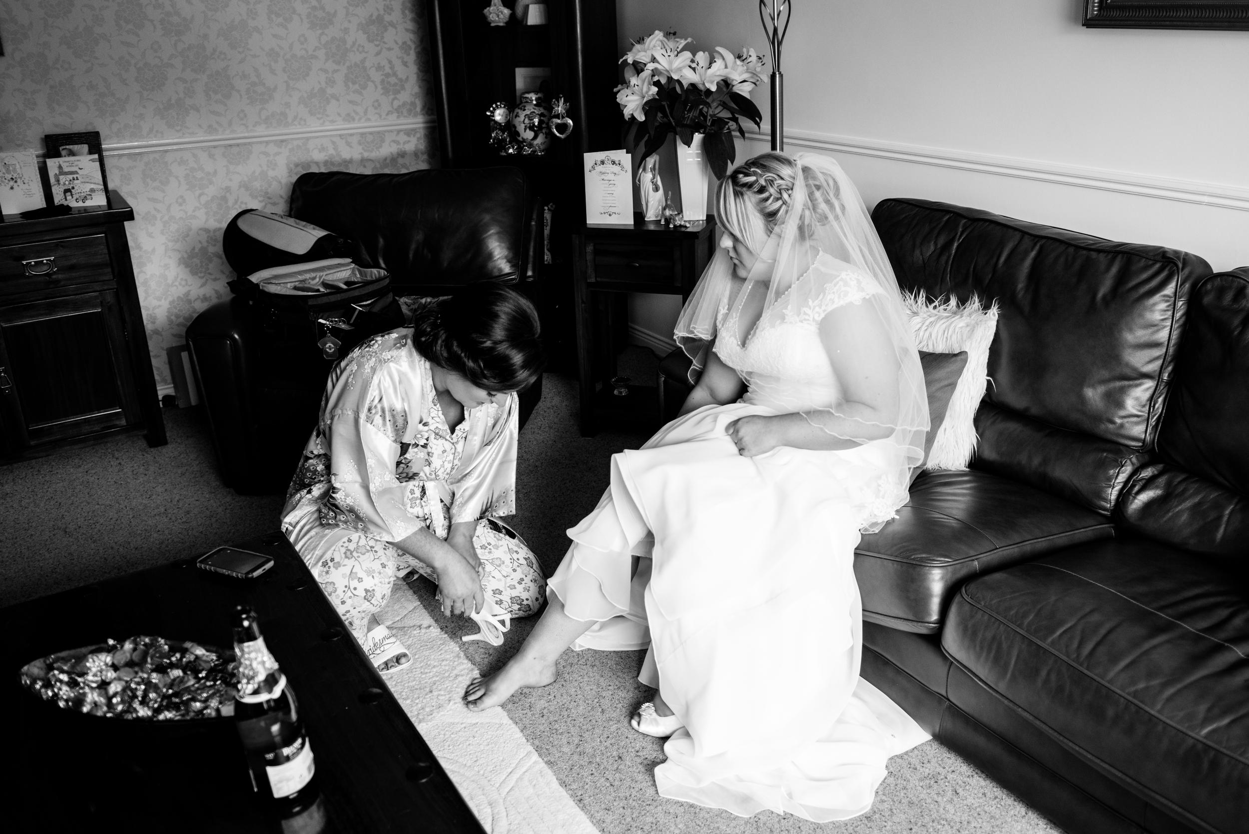 Lisburn Wedding Photographer Pure Photo N.I Magheragall Parish Church bride putting on shoes