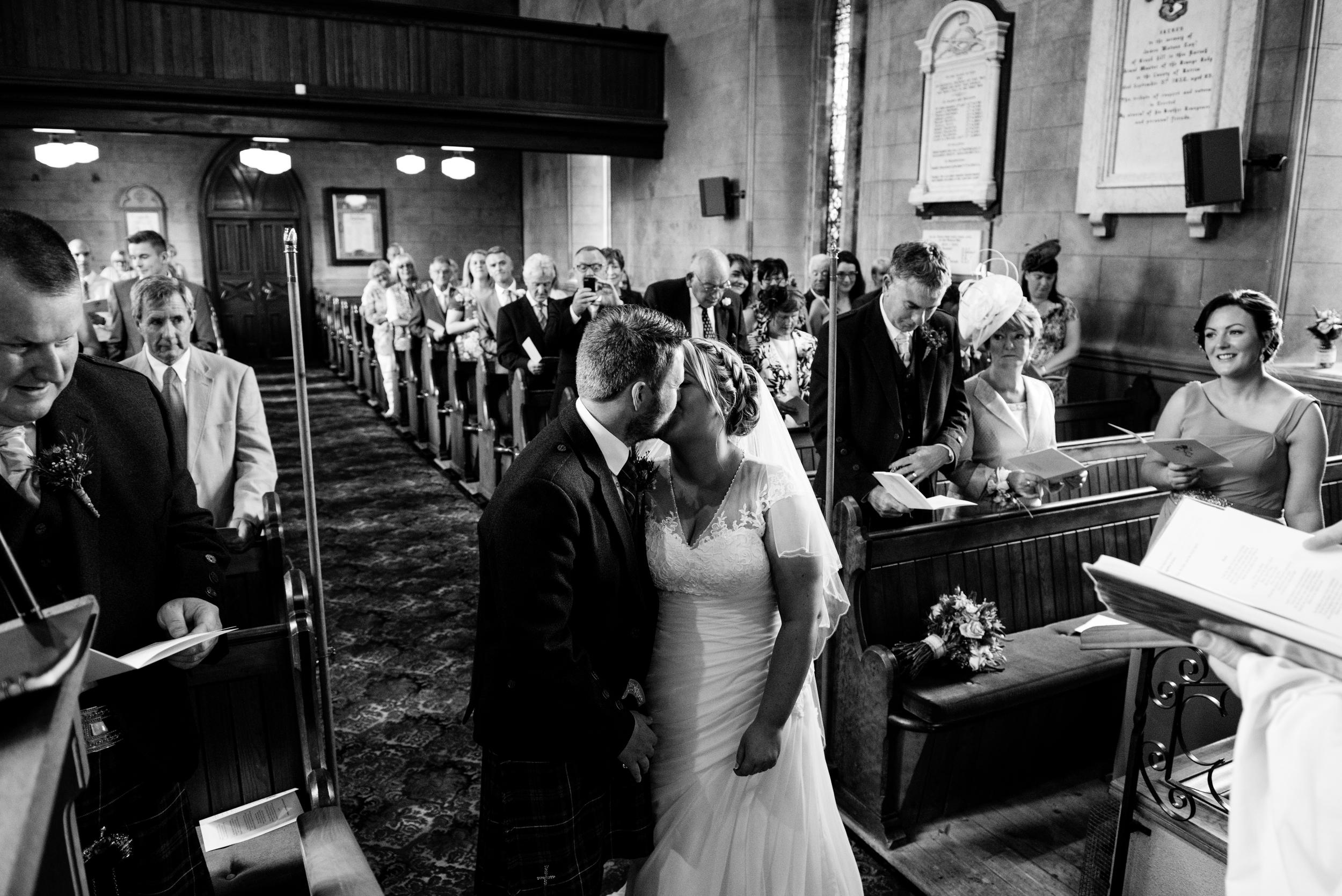 Lisburn Wedding Photographer Pure Photo N.I Magheragall Parish Church ceremony bride groom kiss