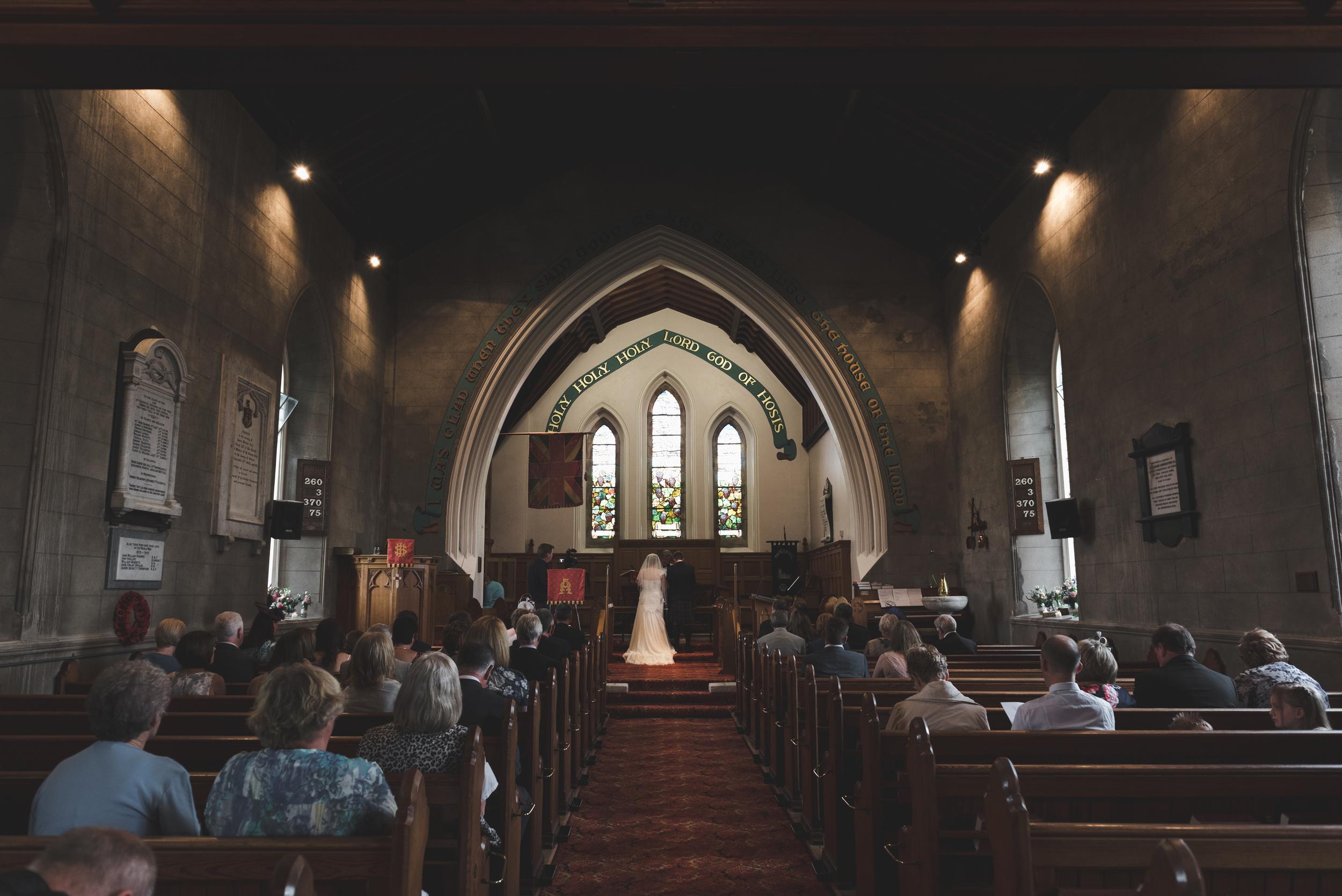 Lisburn Wedding Photographer Pure Photo N.I Magheragall Parish Church ceremony bride groom back