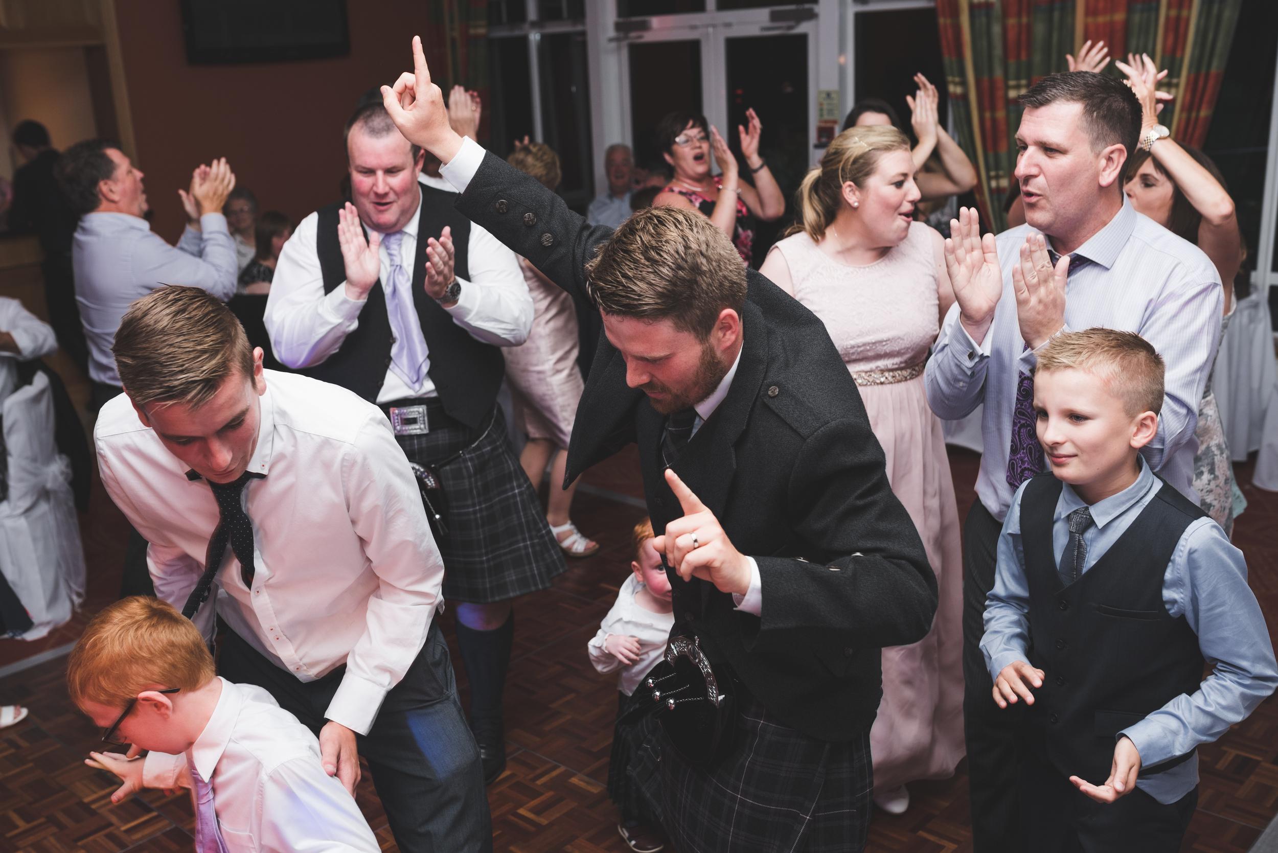 Lisburn Wedding Photographer Pure Photo N.I Edenmore Country Club groom dancing