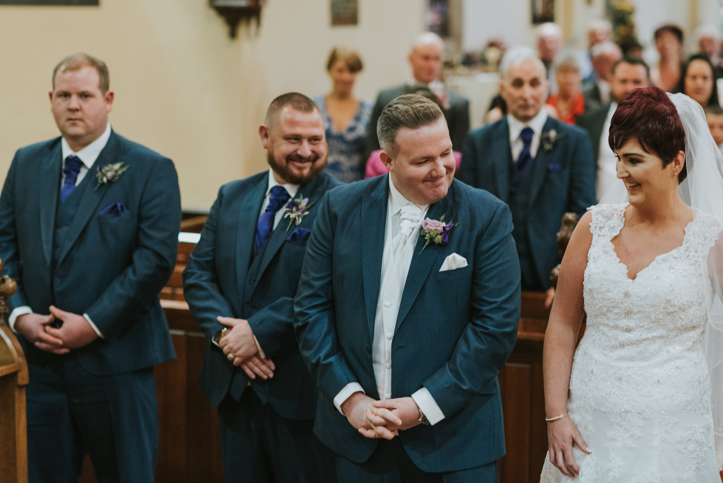 Christ Church Limavady wedding photographer Pure Photo N.I bride groom aisle
