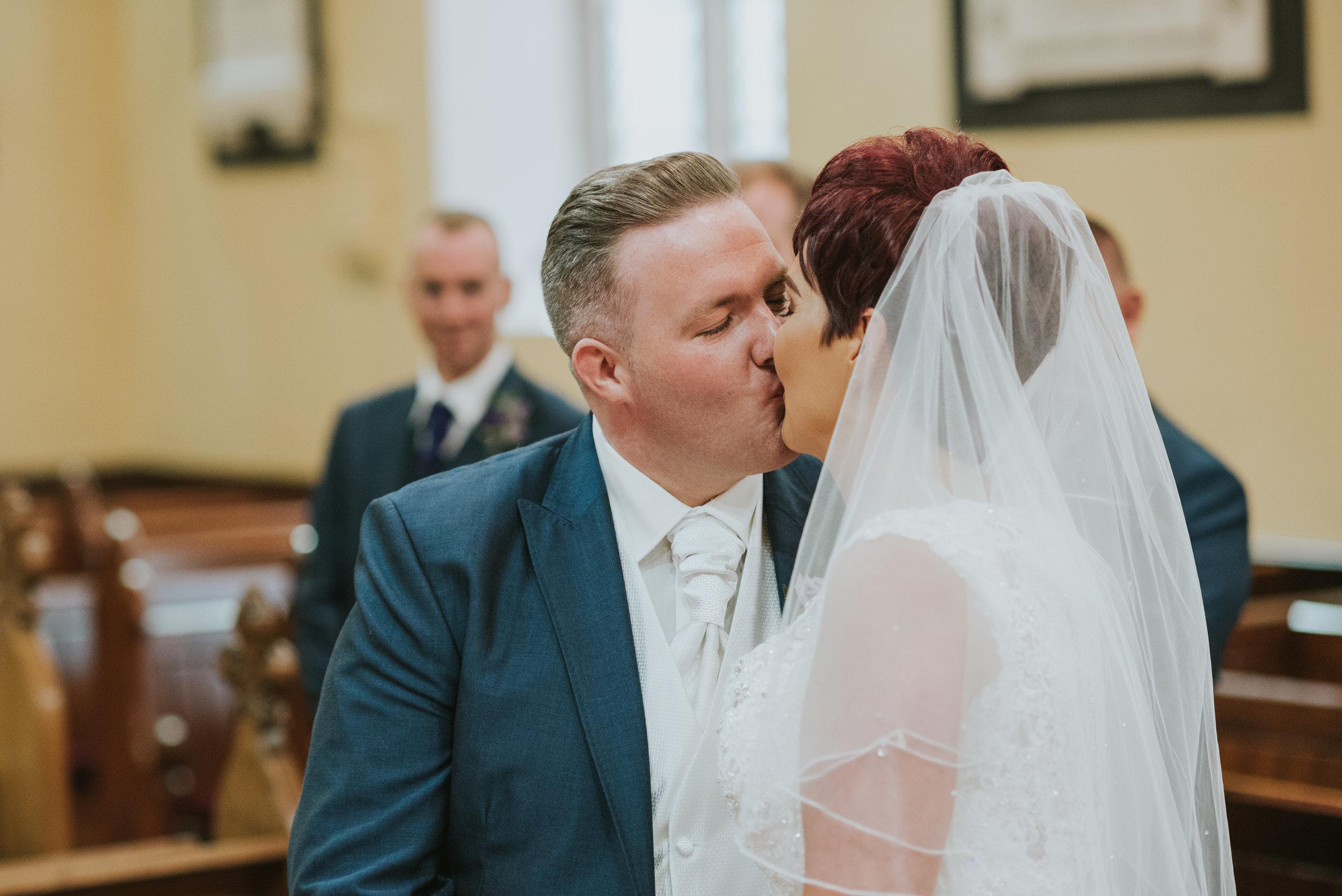 Christ Church Limavady wedding photographer Pure Photo N.I bride groom kiss