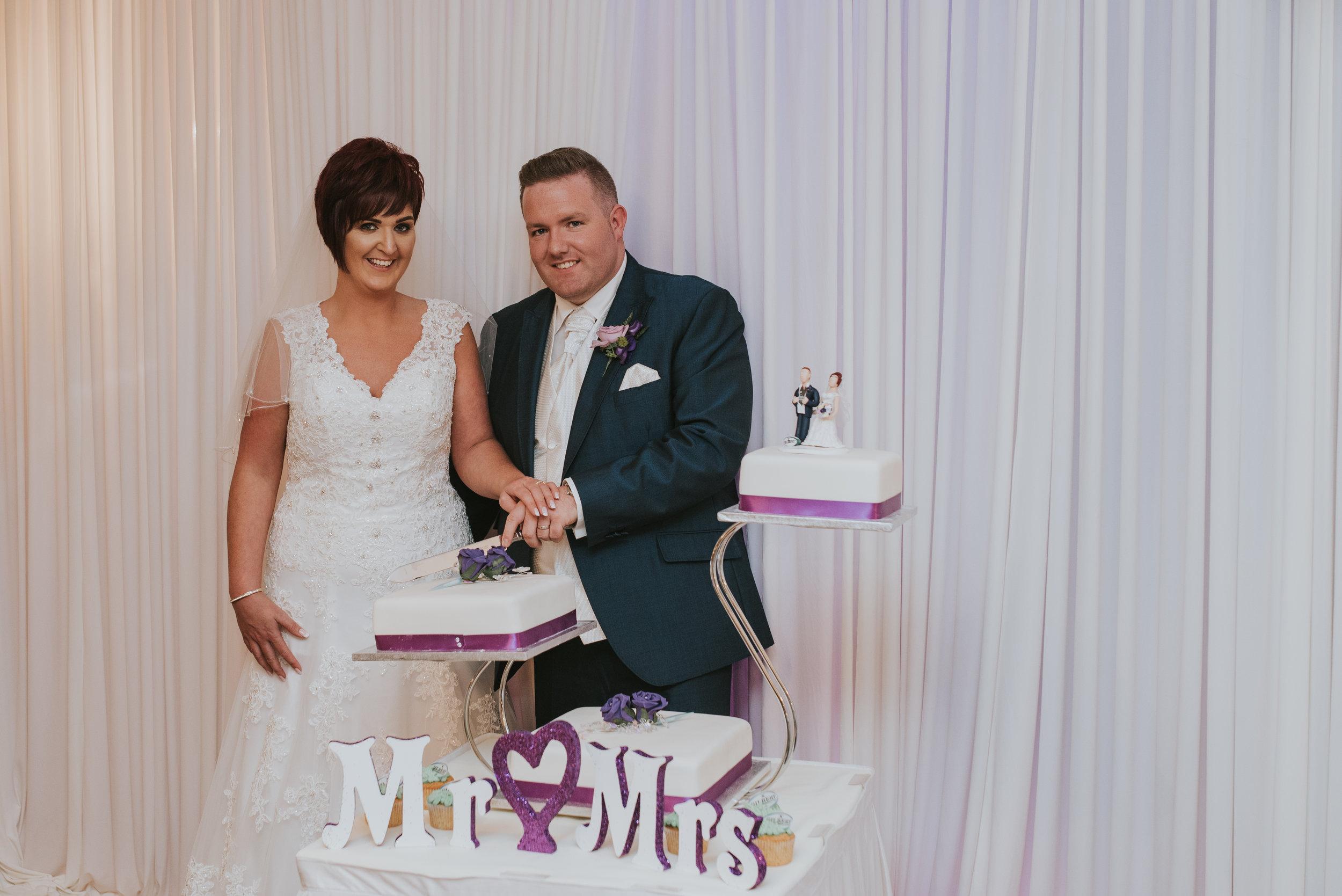 Bushtown Hotel Wedding Photographer Pure Photo N.I cutting the cake