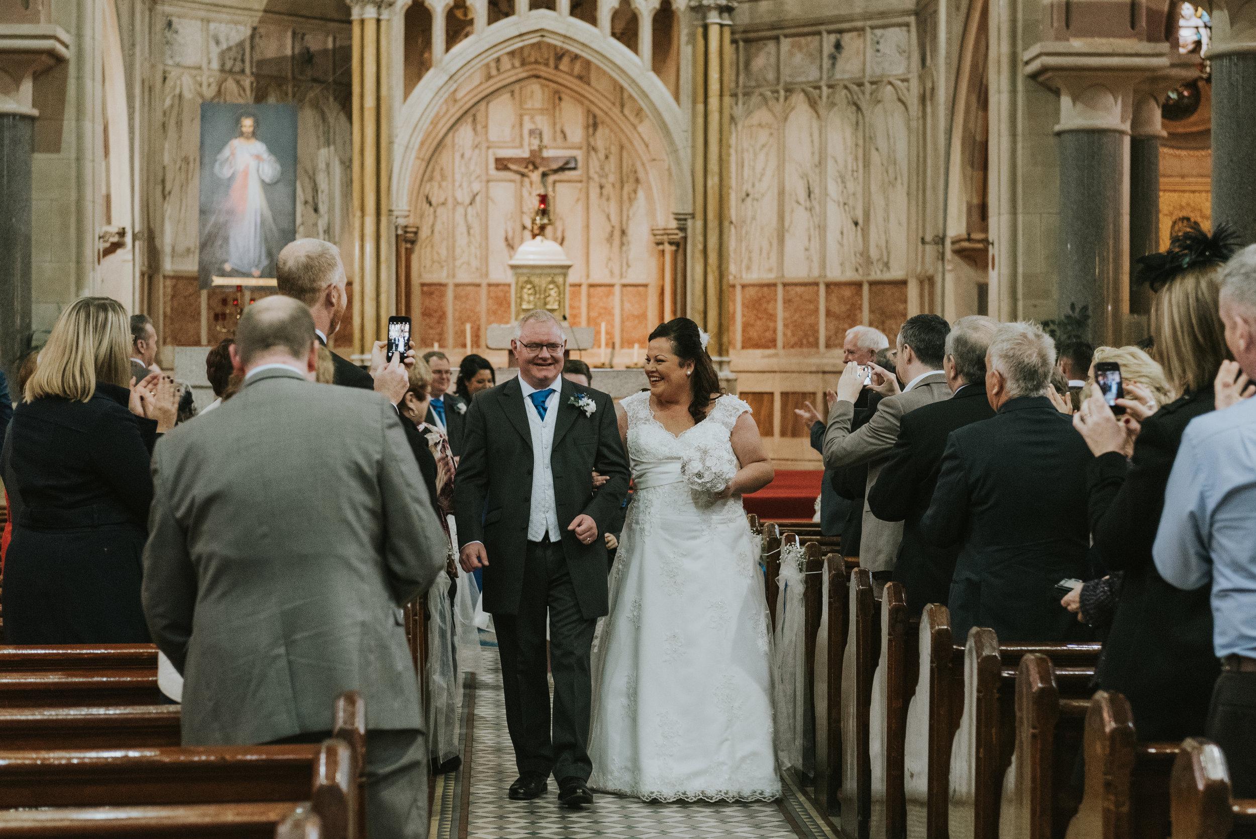 St. Pauls belfast wedding photographer pure photo n.i aisle