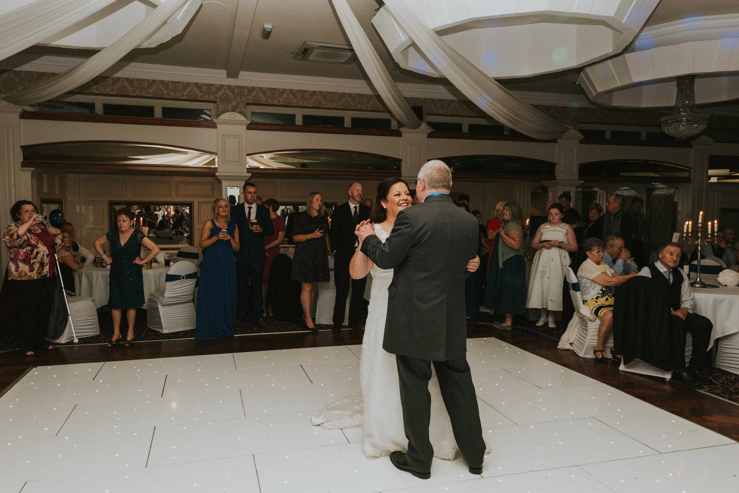 Balmoral Hotel Belfast wedding photographer Pure Photo N.I first dance groom bride