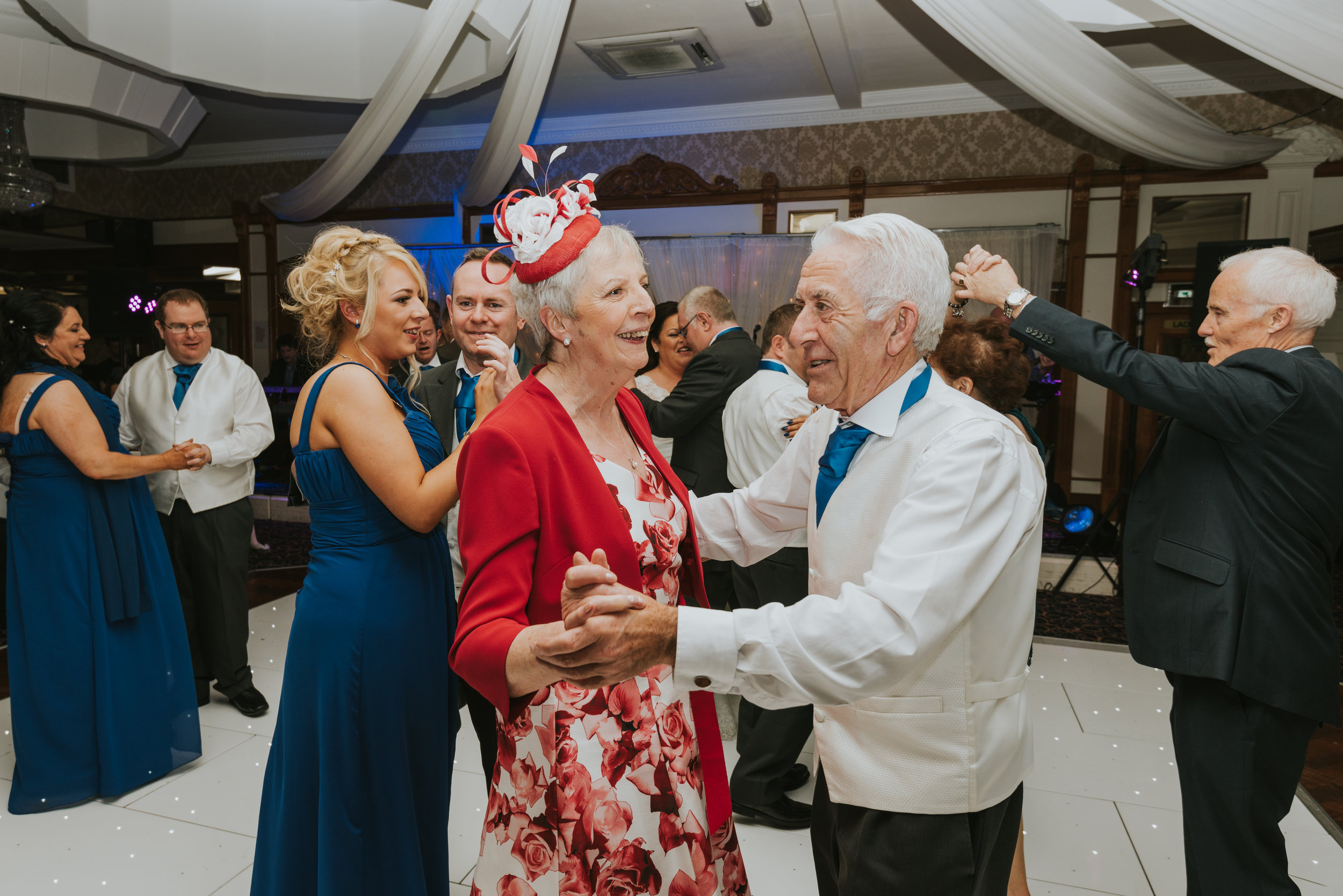 Balmoral Hotel Belfast wedding photographer Pure Photo N.I mother of the bride dancing