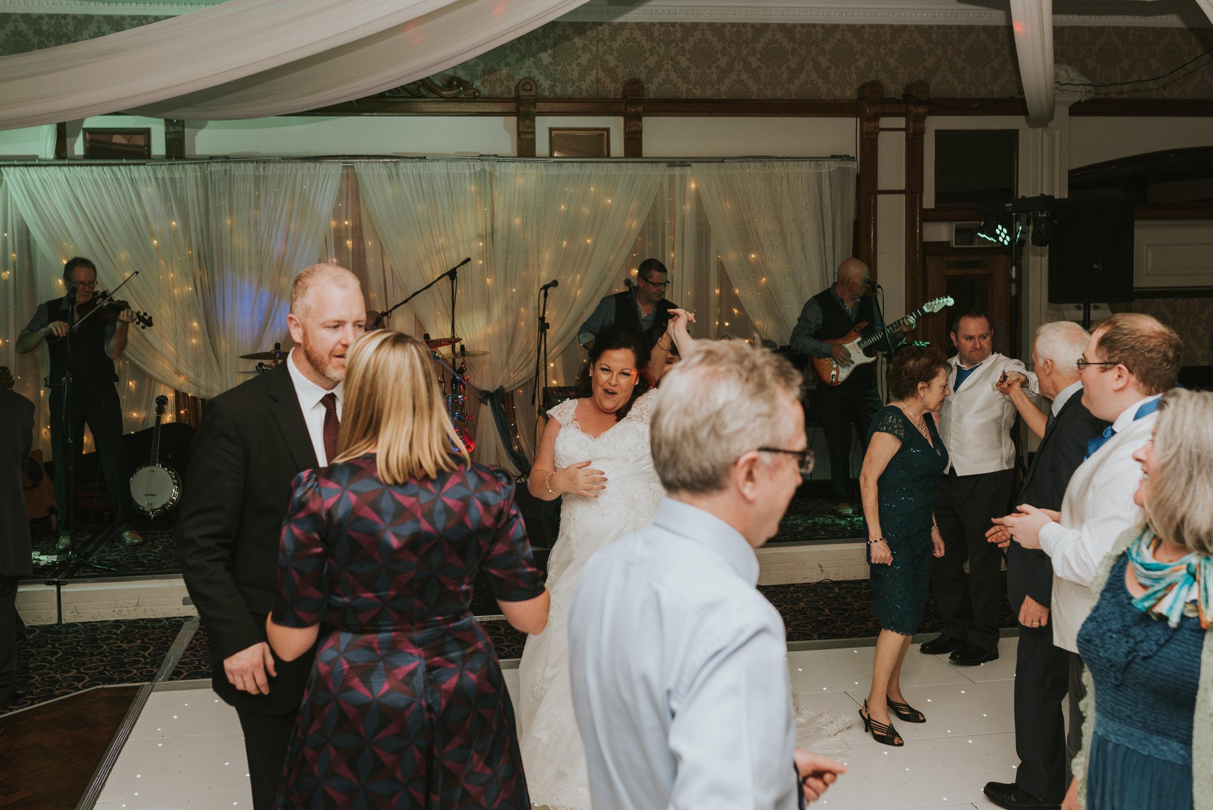 Balmoral Hotel Belfast wedding photographer Pure Photo N.I guests bride dancing