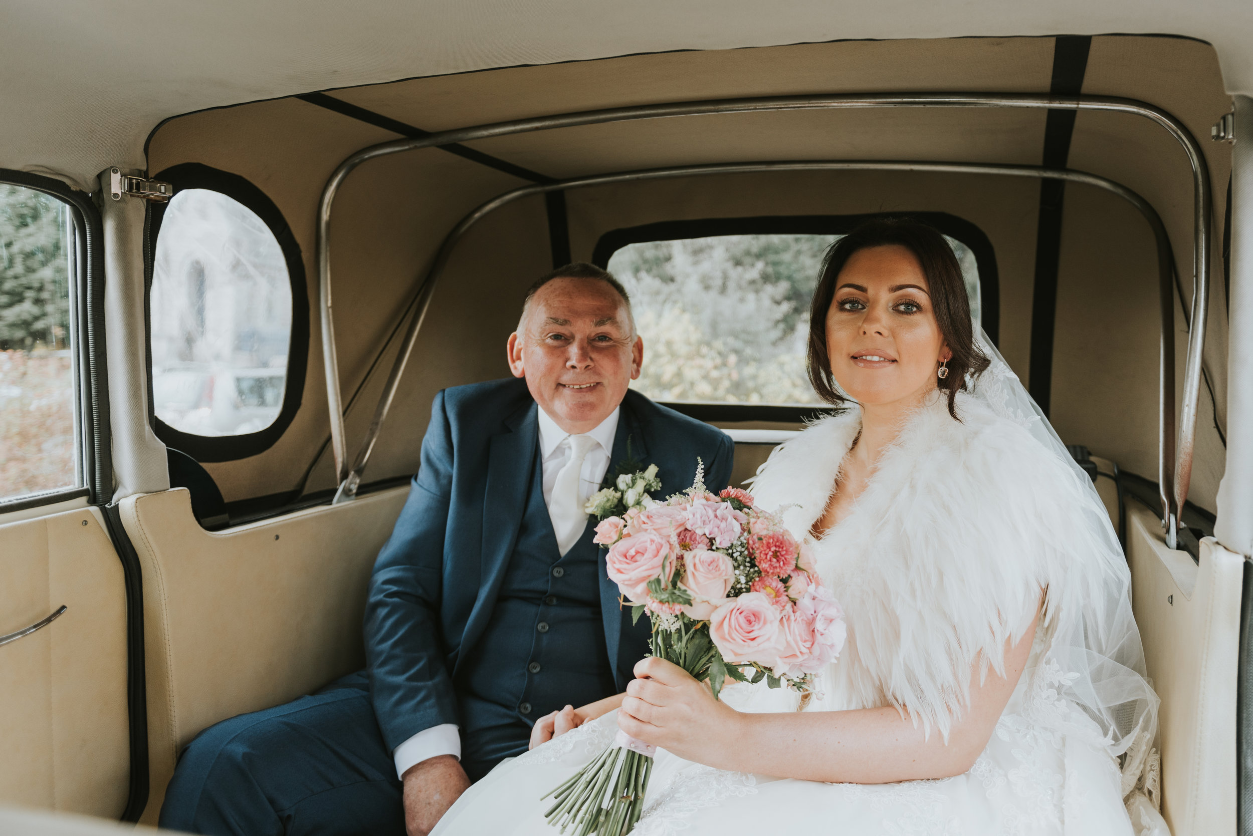 Tullyglass House Hotel Wedding ceremony bride with father in wedding car
