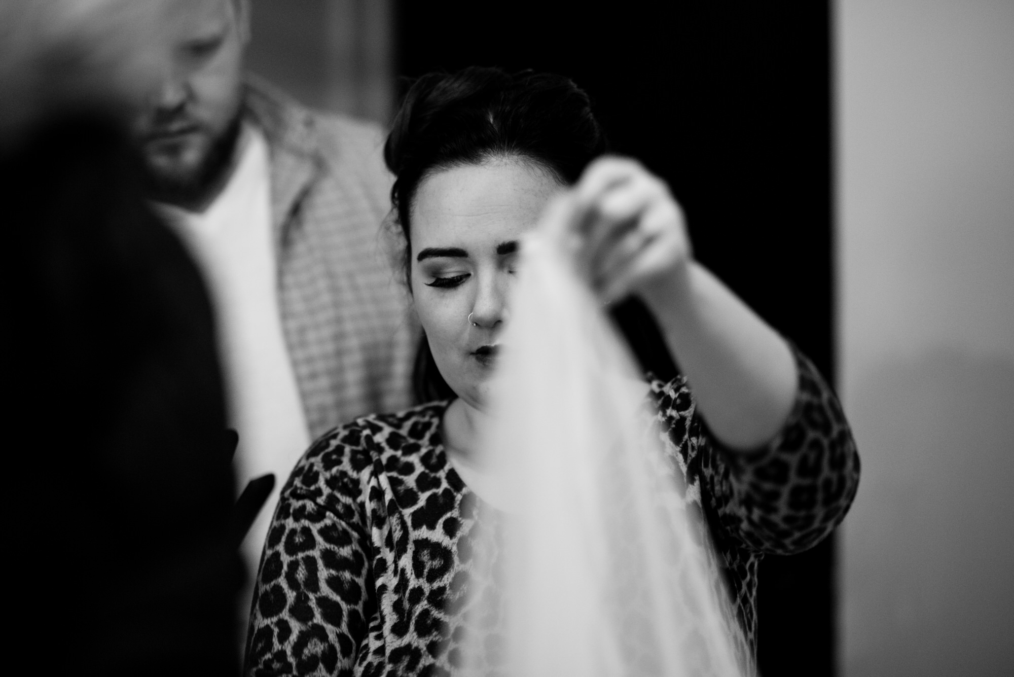 ten square hotel wedding getting ready bride with veil