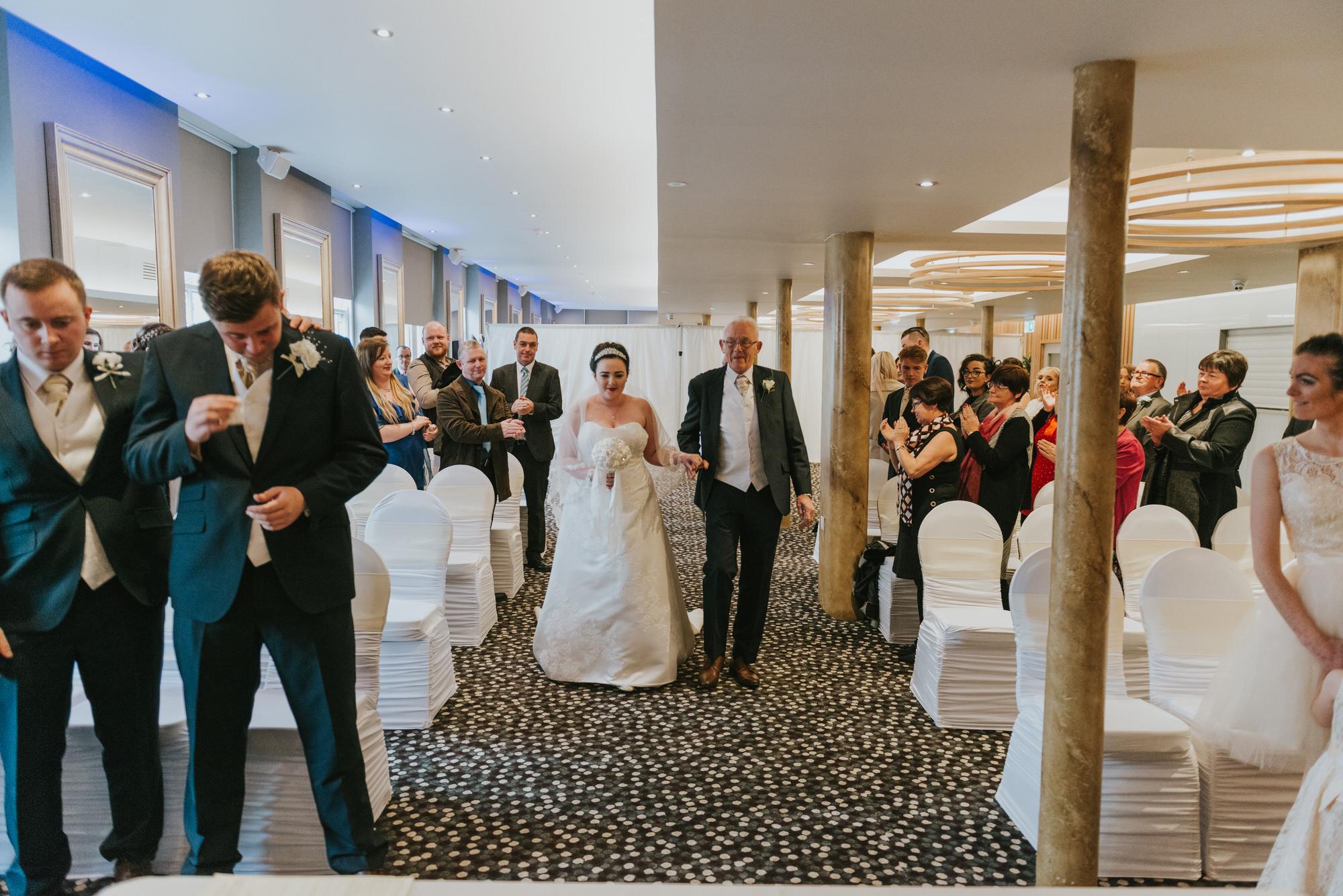 ten square hotel wedding ceremony belfast groom crying bride