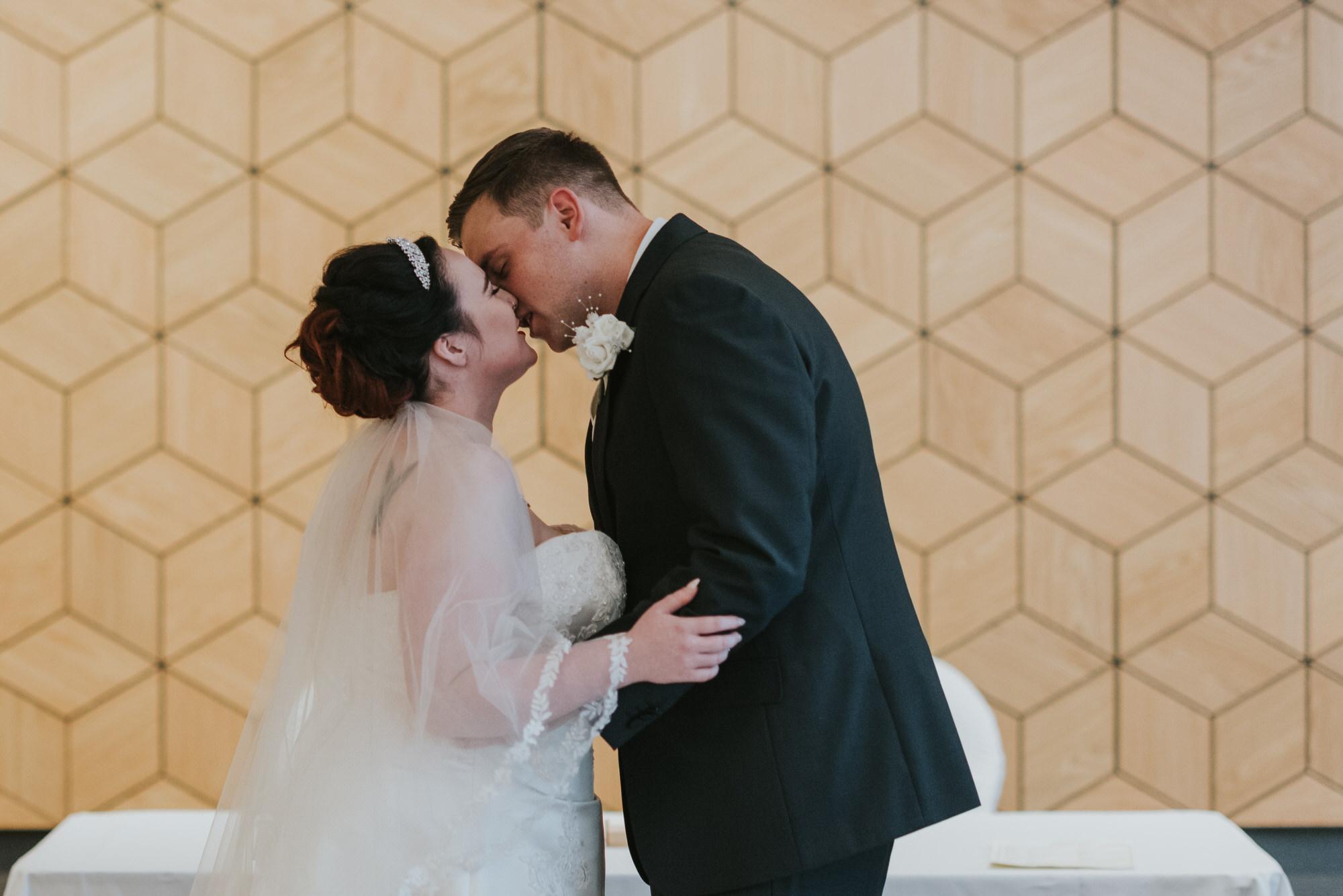 ten square hotel wedding ceremony belfast groom bride kiss