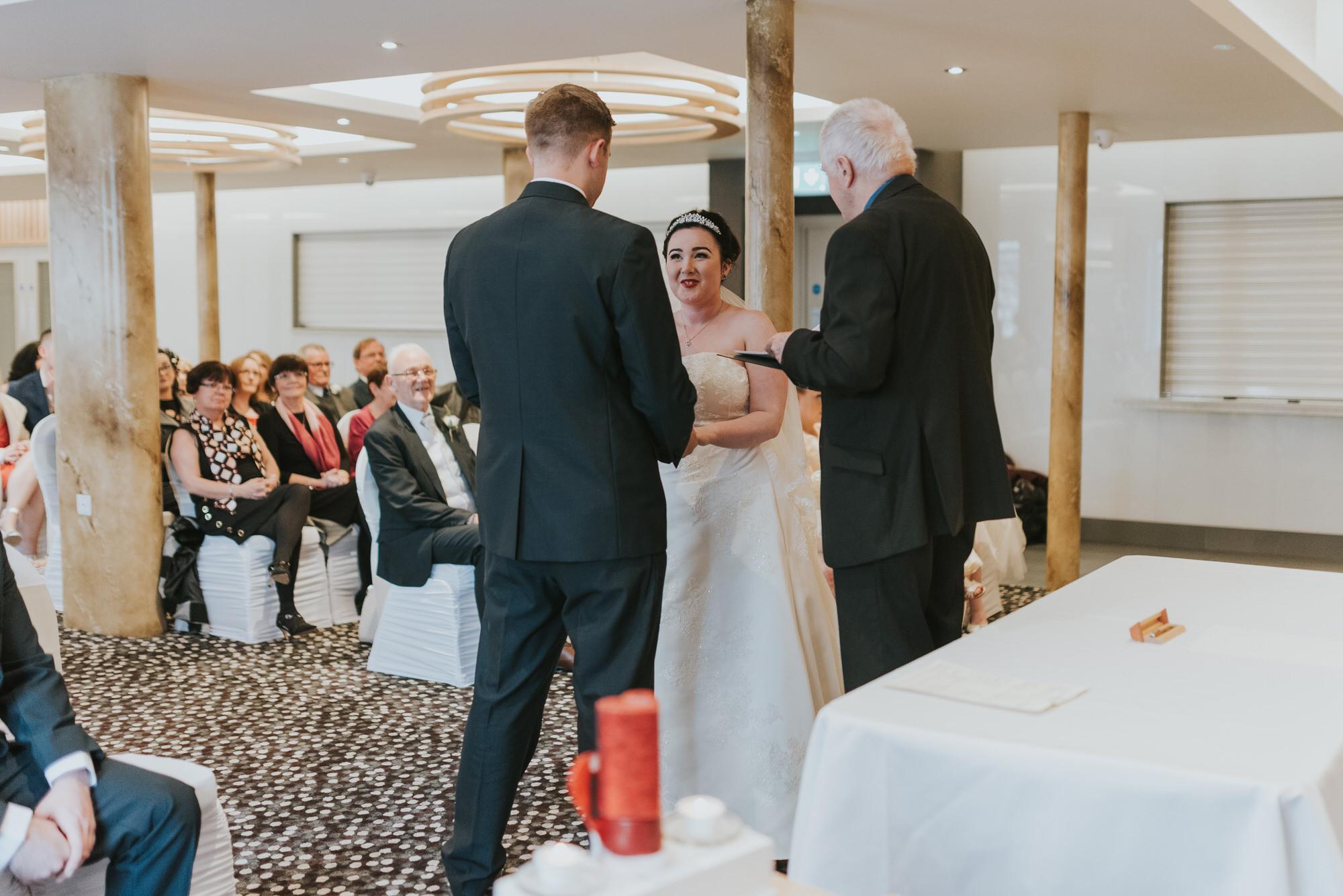 ten square hotel wedding ceremony belfast groom bride together