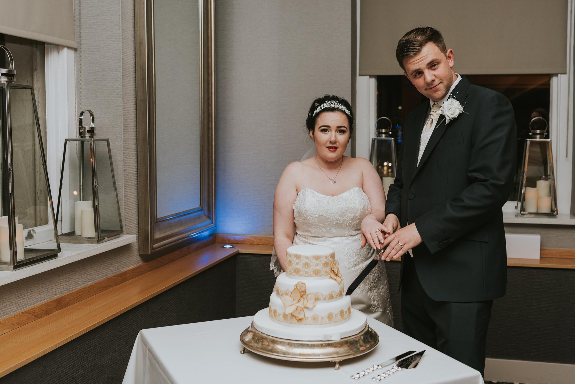 wedding photographer belfast ten square cutting the cake