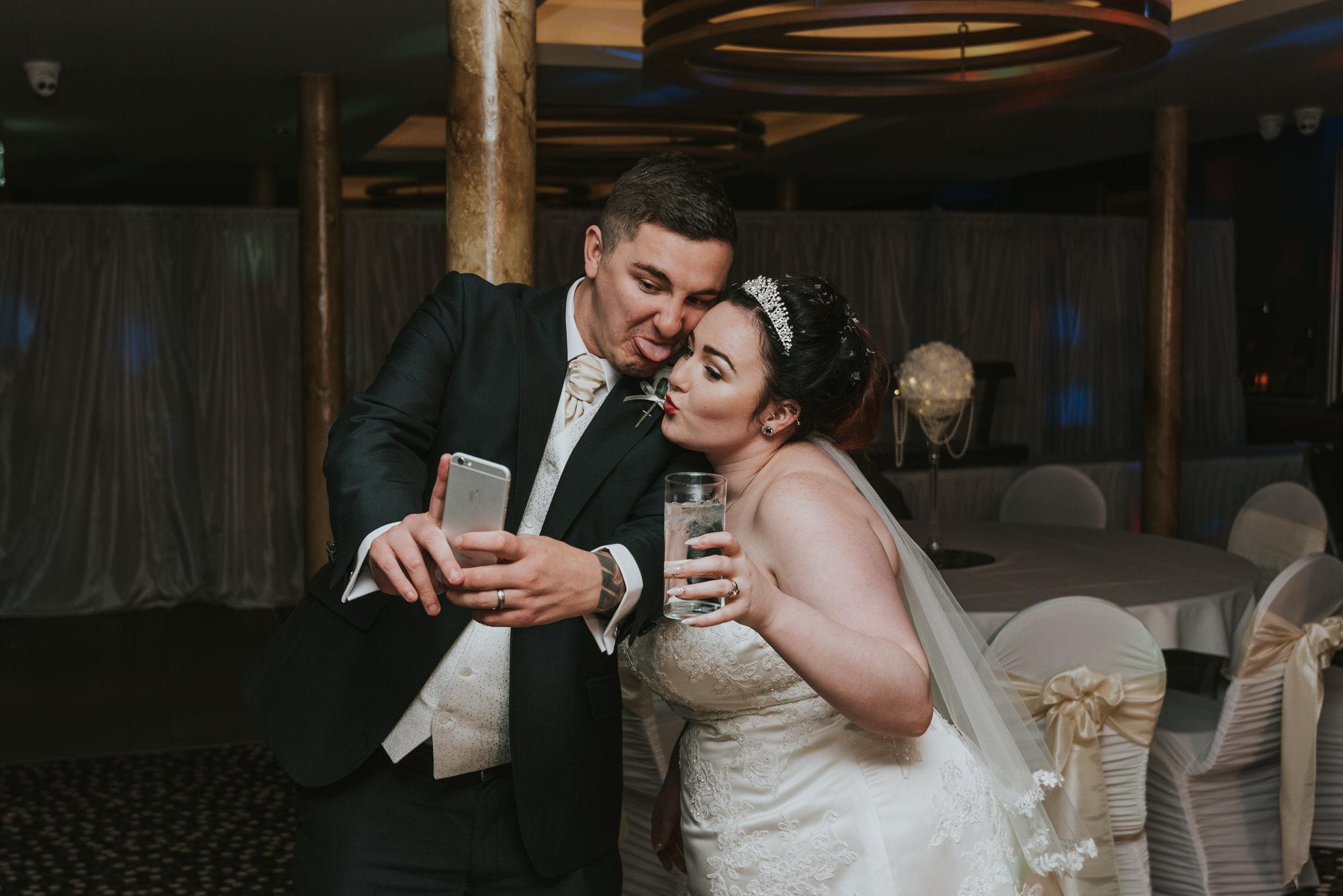 wedding photographer belfast ten square hotel bride and grooms man selfie